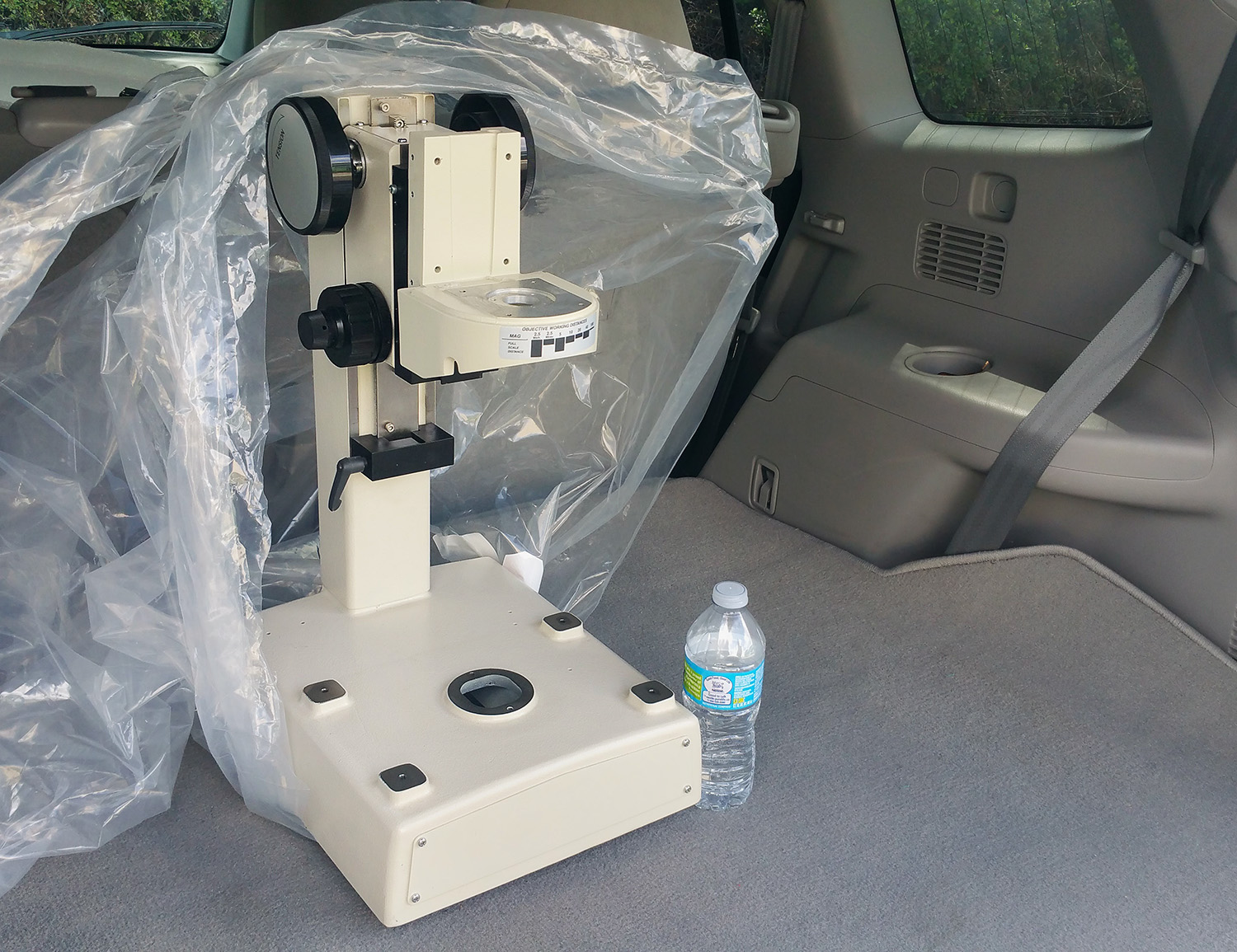 The Zygo NewView 200 Microscope Stand with bottled water for scale.
