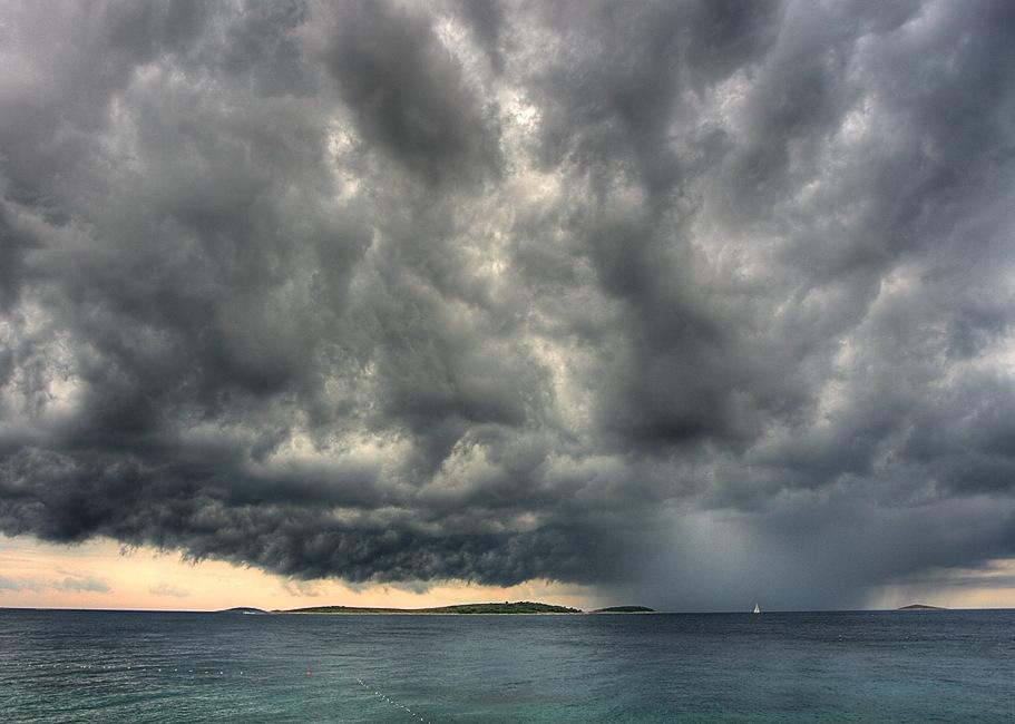 Tiny boat big storm.jpg