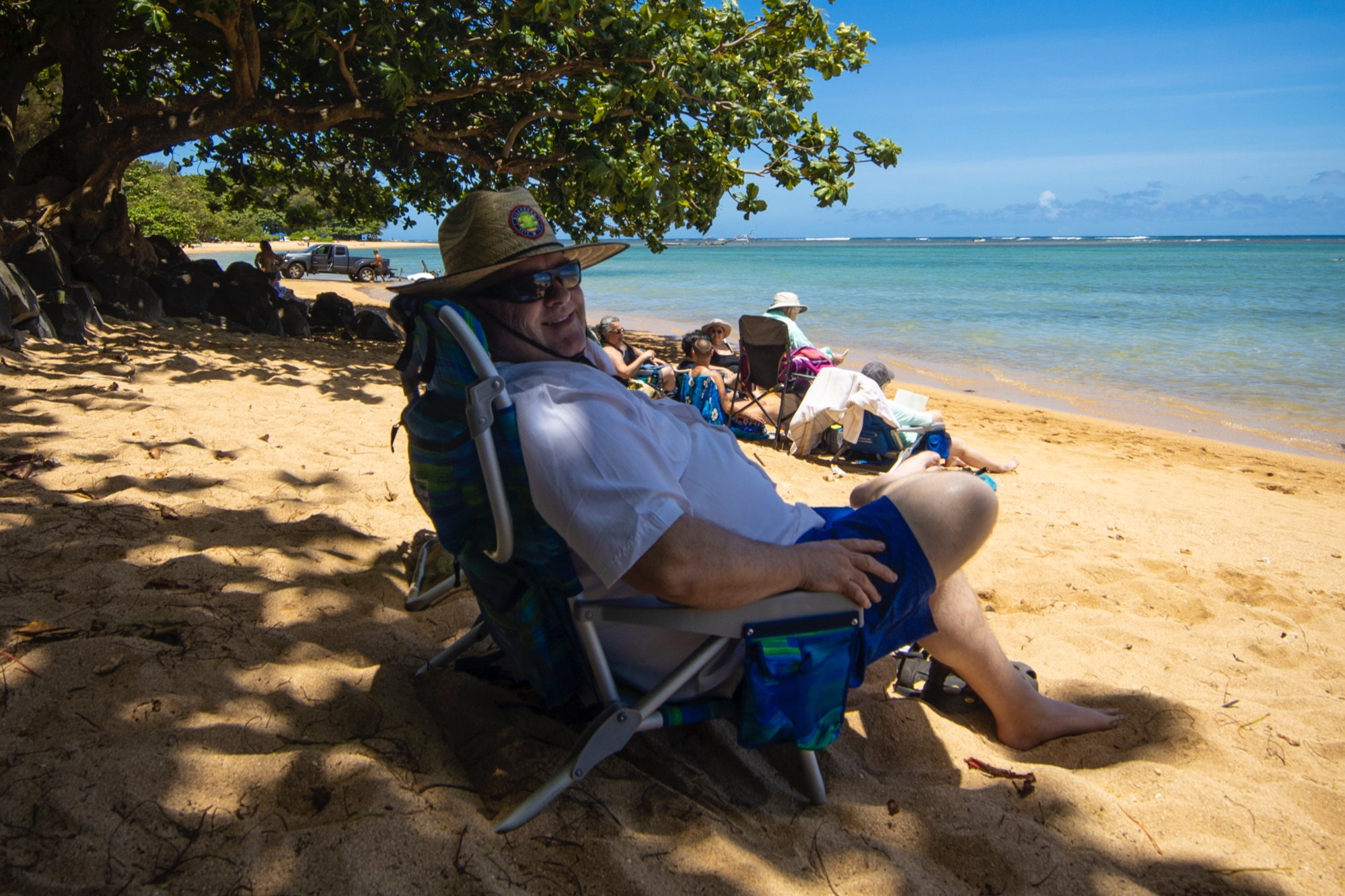Dad lounging on the beach