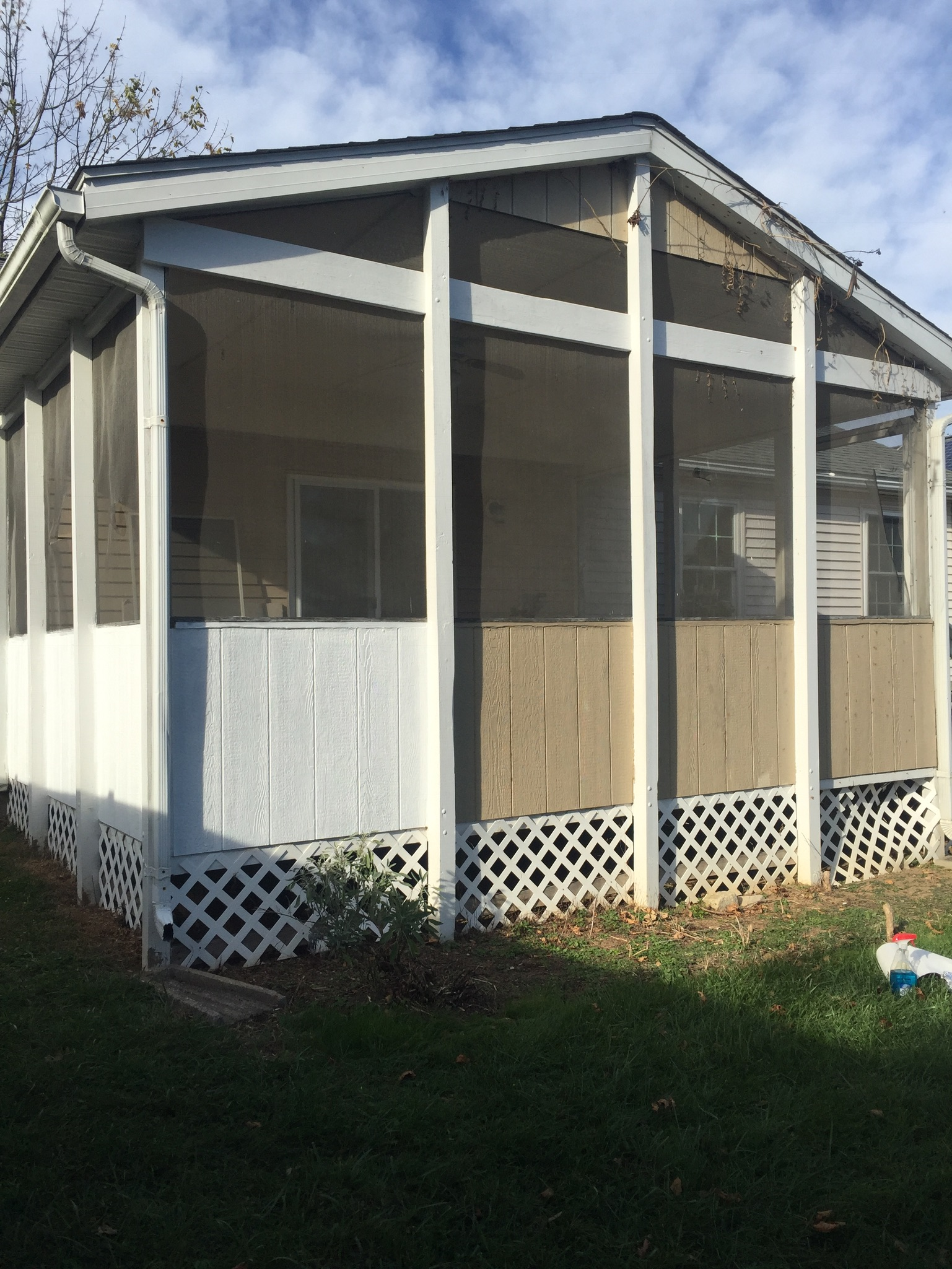 Painted trim on screened in porch; replaced screens.