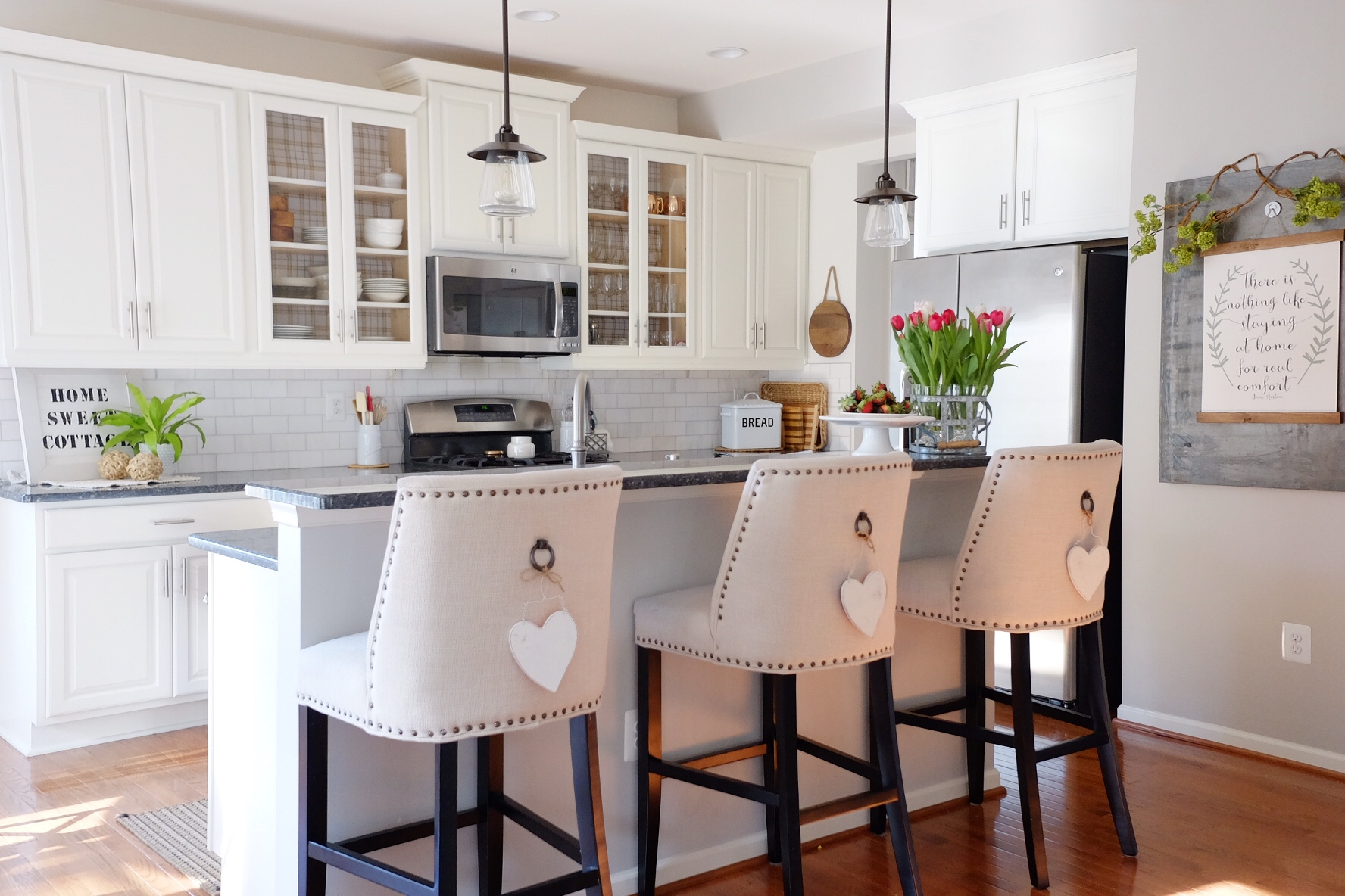 Paint: Shell White SW 917 (Satin finish); canvas Print: The wooded lane; Pendant lights: lowes