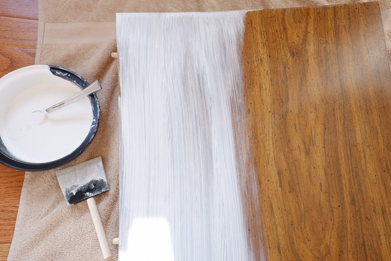 Apply Whitewash paint to section of table.