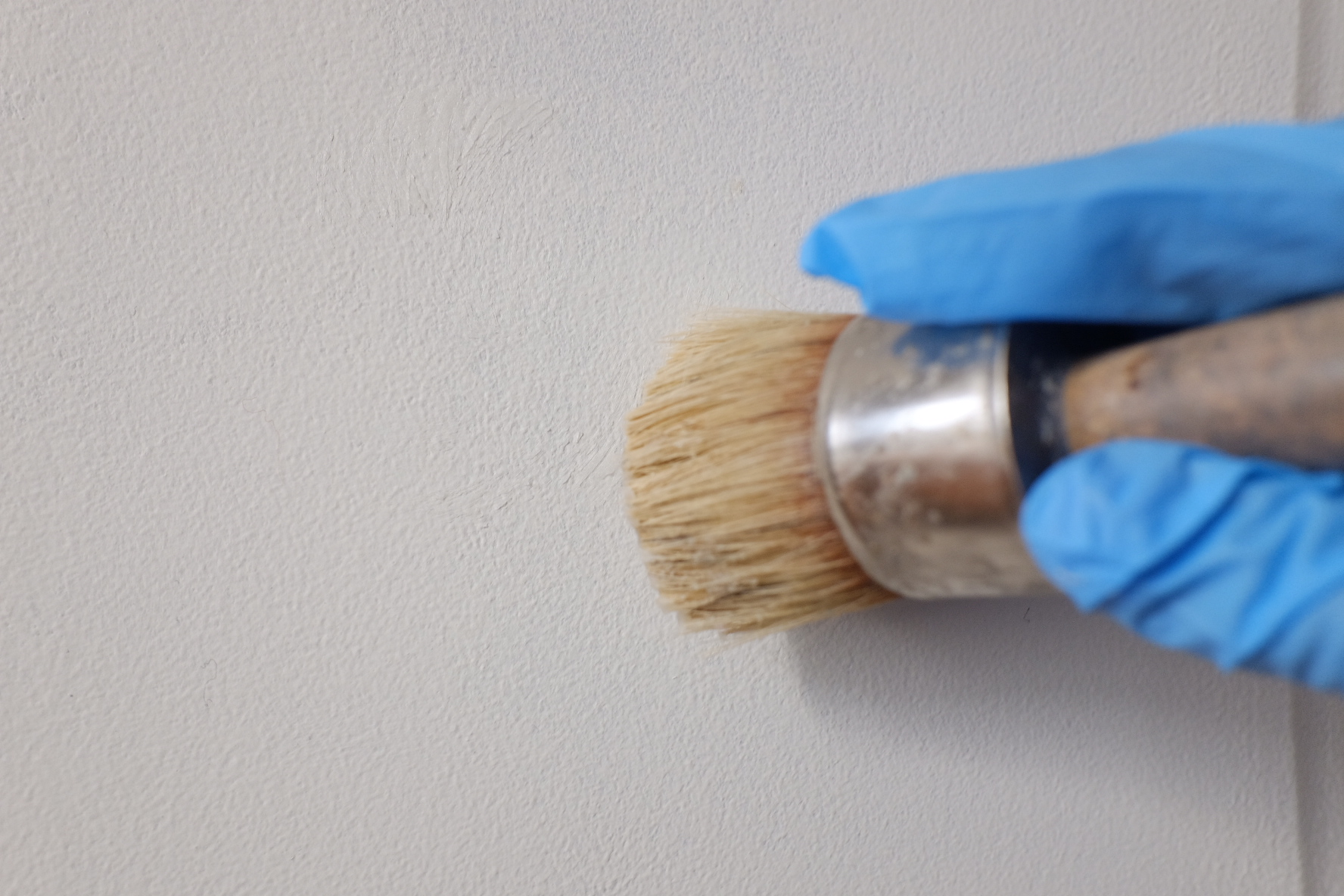 Use circular motions to apply the wax into the paint then buff with a lint free cloth.