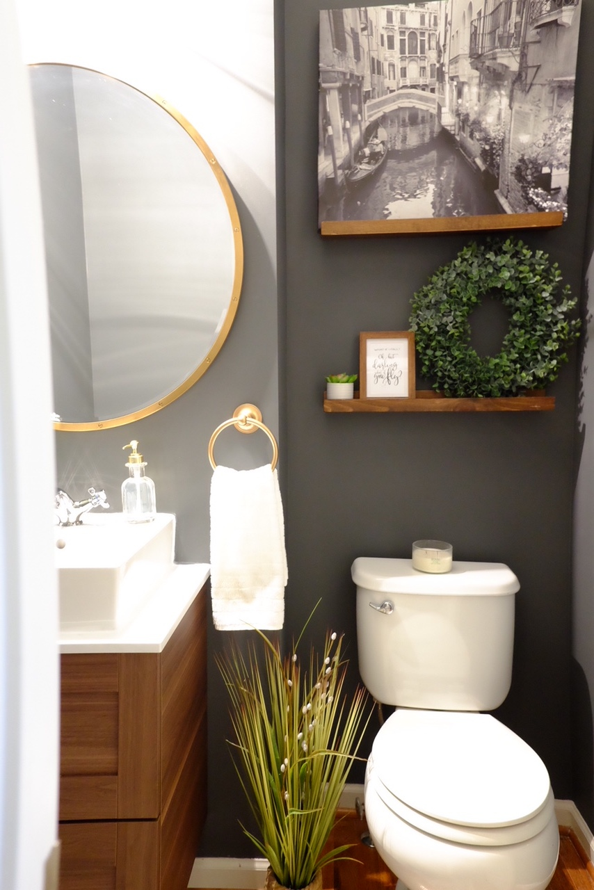 Plant and Eucalyptus wreath are from @Homegoods, Wooden shelves are from @Target