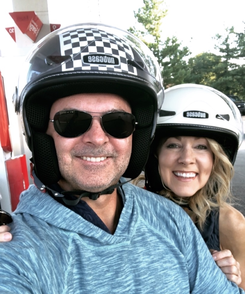 My hubby and me on his Vespa. :-)