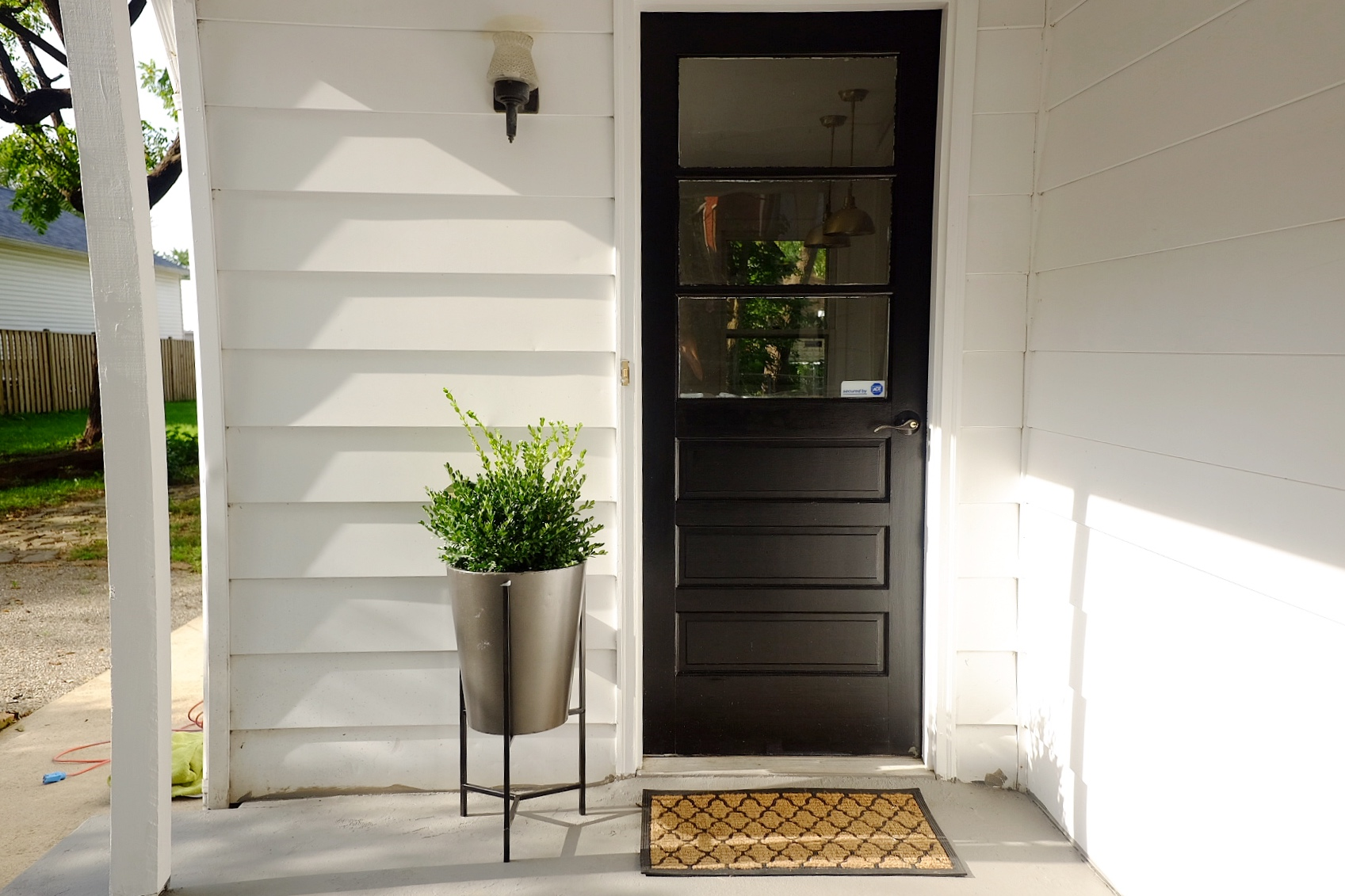 We painted this door on the side porch a classic black color to make it stand out from the white siding.