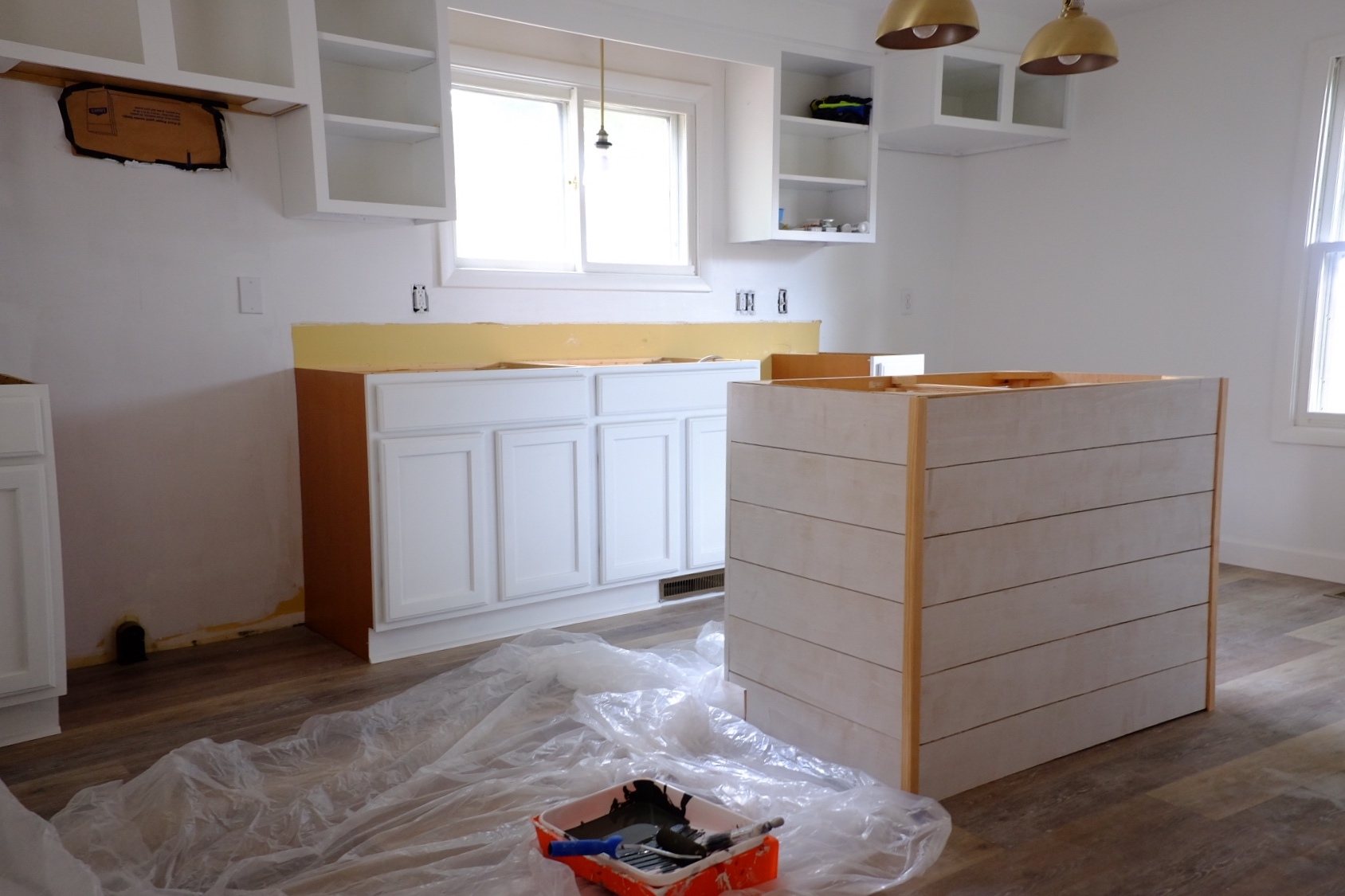 We purchased remnant pieces of quartz for the countertops and shiplapped the island which we found at Habitat for Humanity.