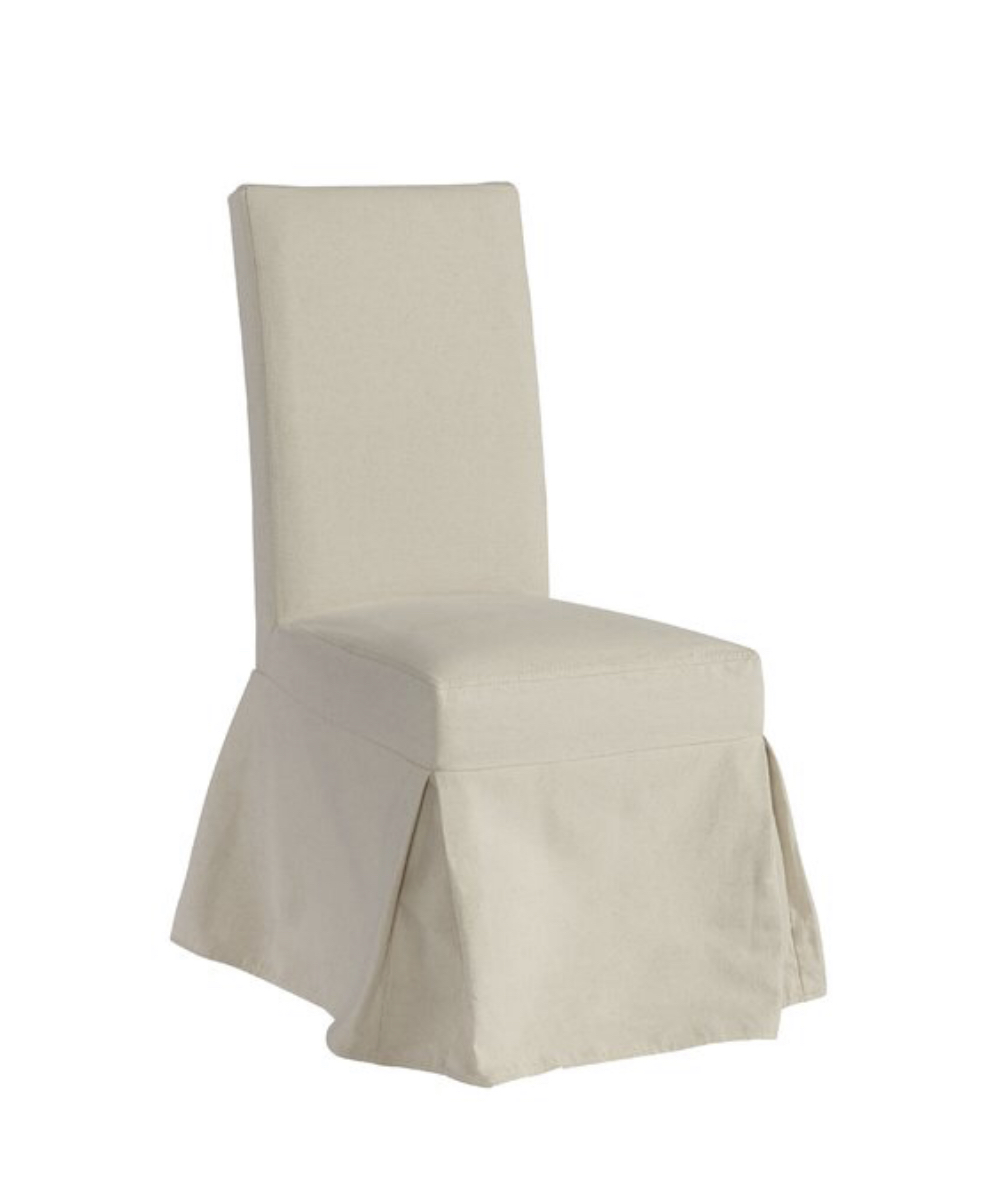 Dining Room: White slipcovered chair