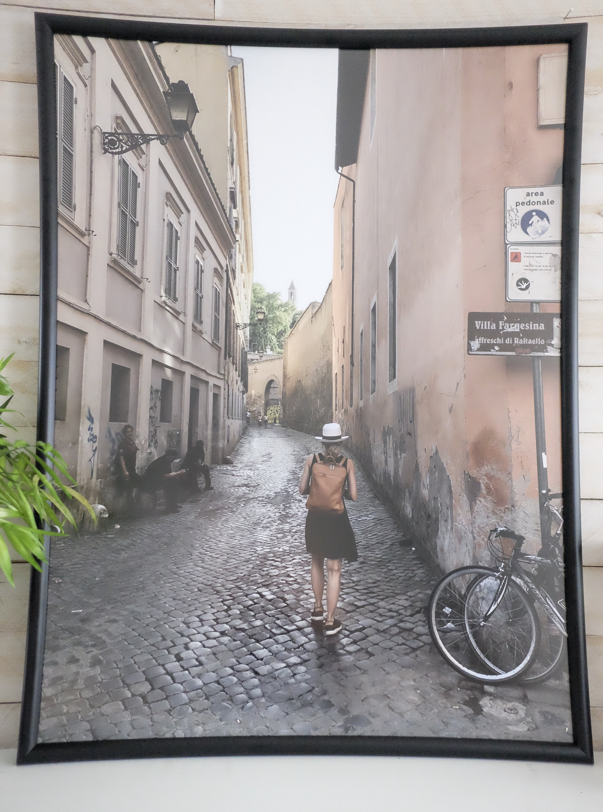 My husband snapped this picture on his iPhone as I was walking along one of the streets in Rome. He loves it so we had it blown up! We're putting it in his office but for now, it's gracing our Dining Room!