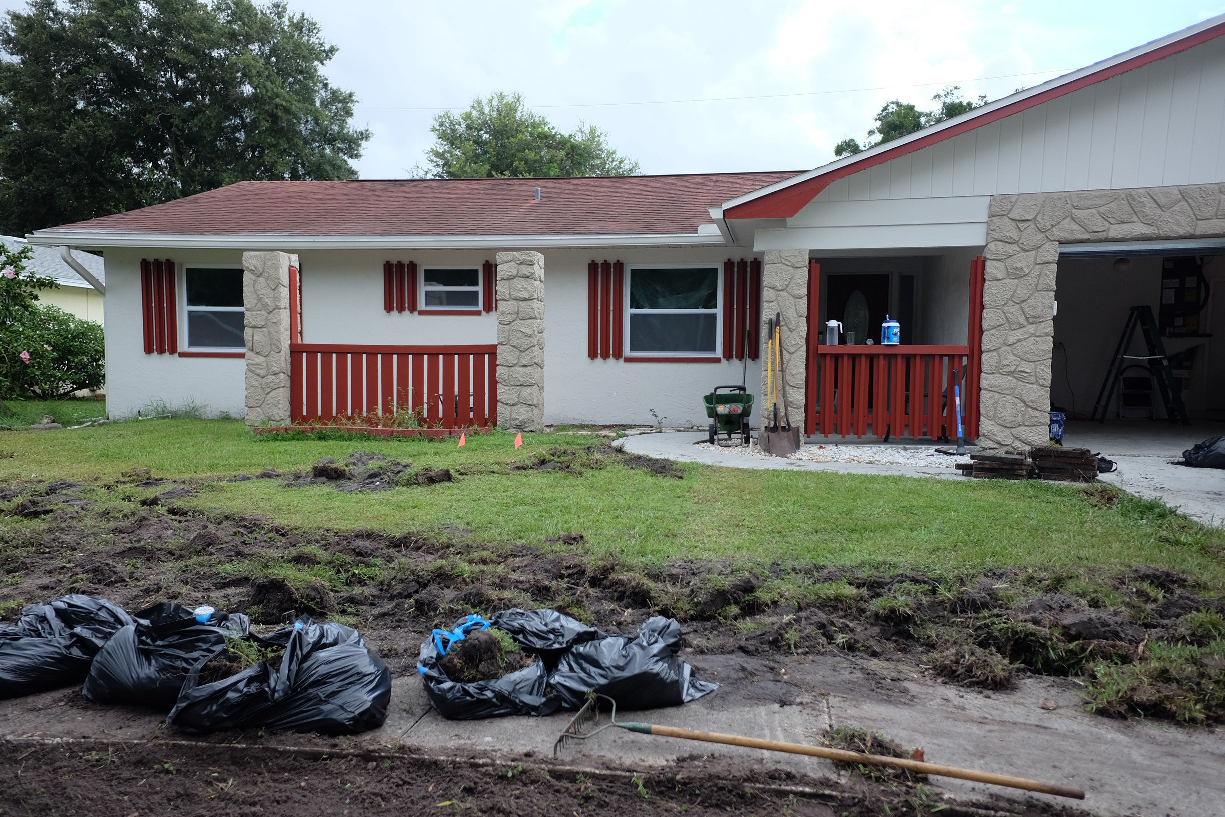 Tearing out front yard grass and placing down sod.  Cottagestyleblog