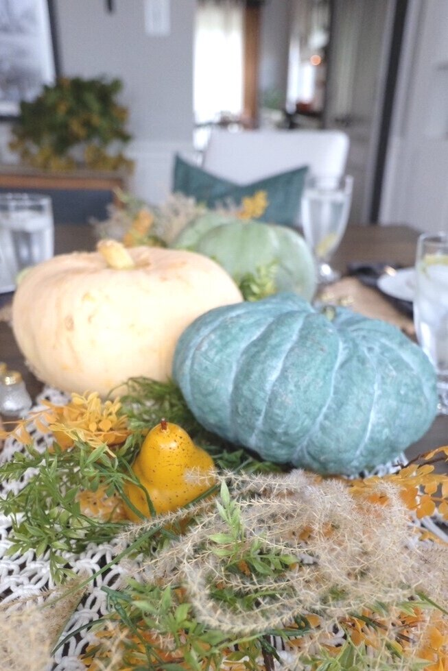 Fall centerpiece using pears, pumpkins and greenery.  Cottagestyleblog.com