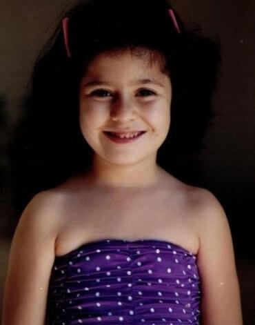 Age 4, happy in my body, in my favorite swimsuit.