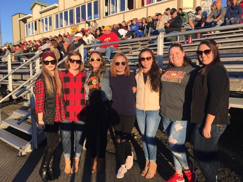 Sarah and friends at school football game.jpg