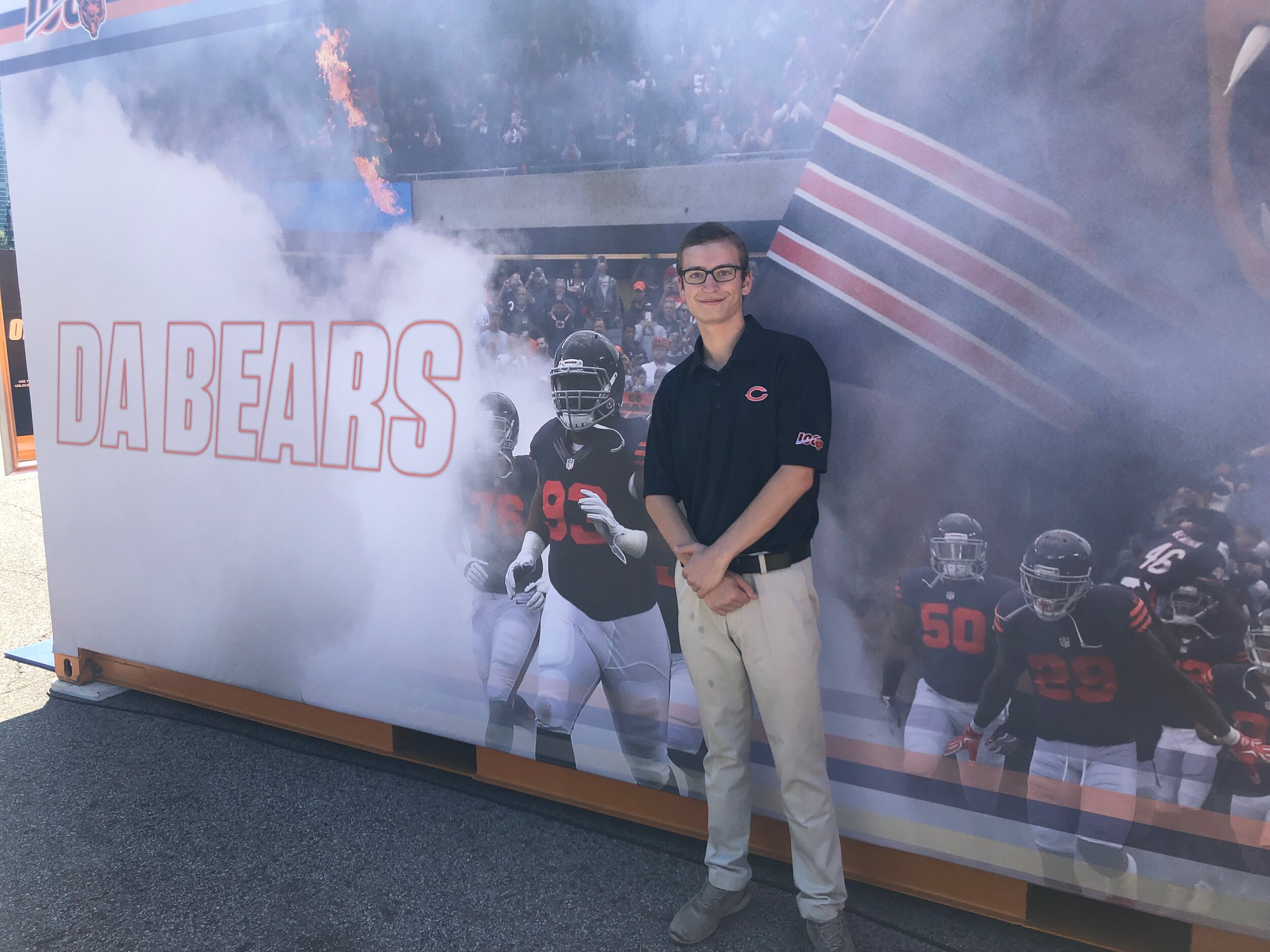 Dressed in game day work attire, Sean poses for a pic at Soldier Field, home of the Chicago Bears