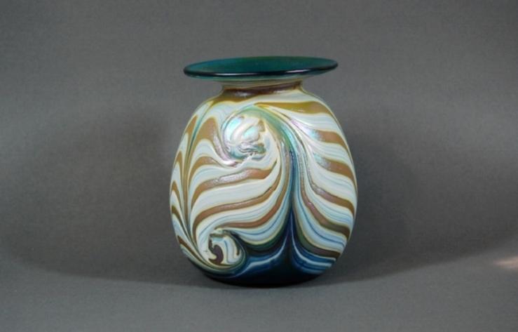 Green vase with white cobra wrap.