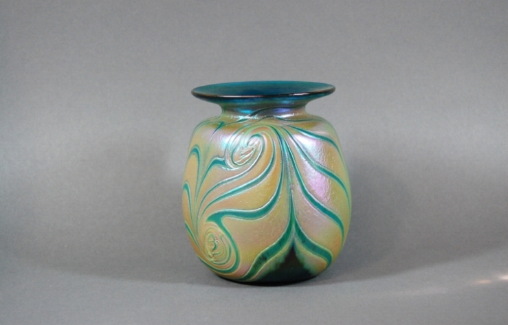 Green vase with cobra wraps.