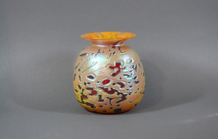 Mango vase with red frit and black cane.