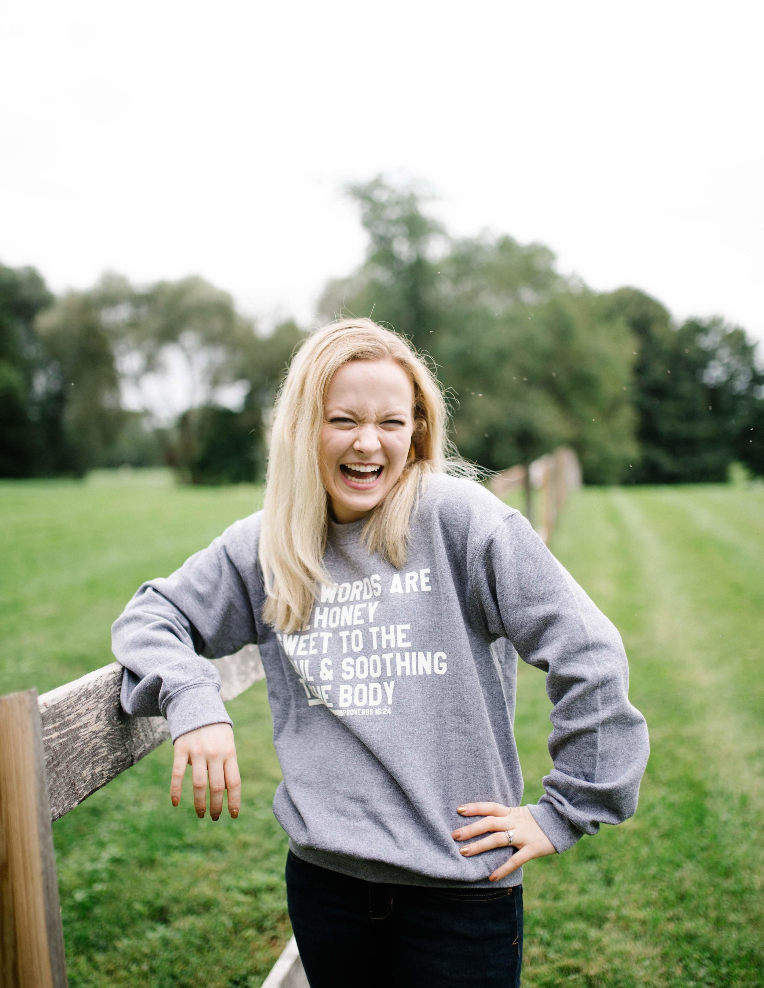 JUlia happily rocking her KInd WOrds Sweat shirt