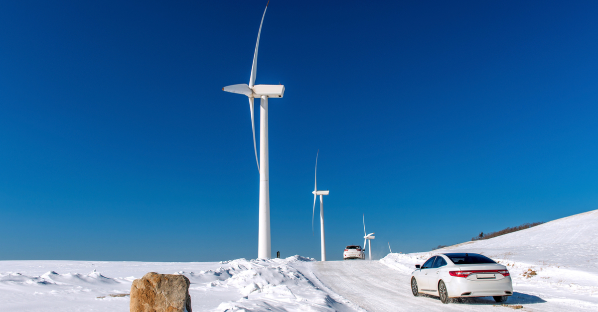 stock-photo-wind-turbine-and-car-with-blue-sky-in-winter-landscape-378272140.jpg