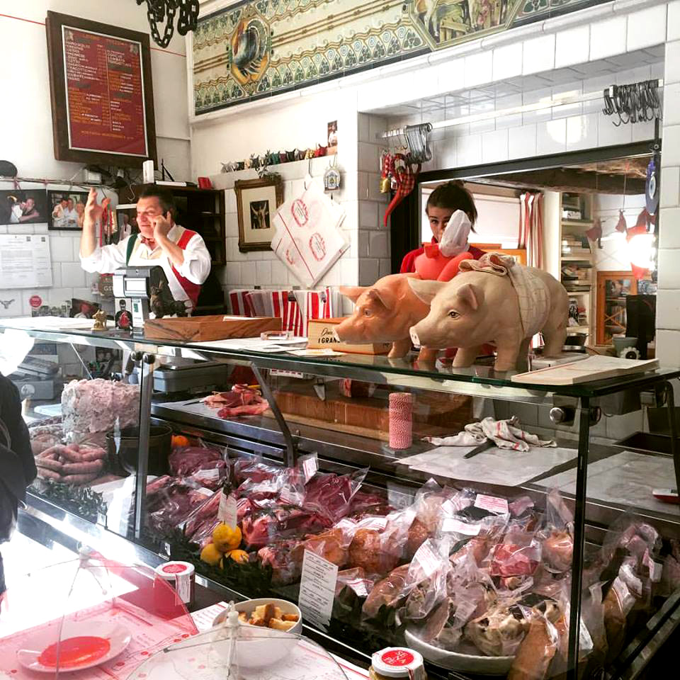 Dario manning the counter of his butcher shop.