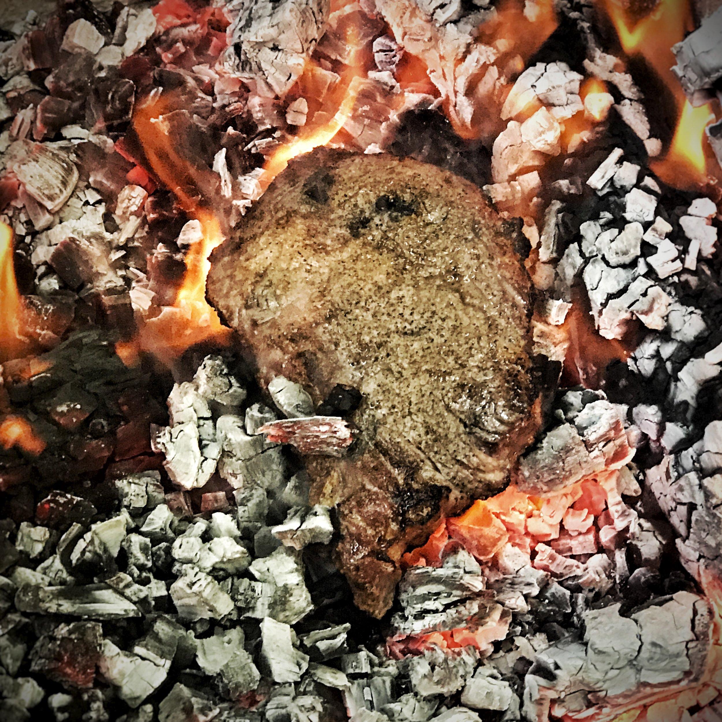 A dirty steak on the coals. (Salt and Pepper)