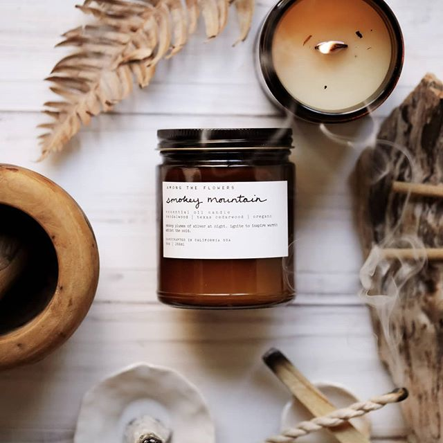 Sometimes all it takes is a cup of coffee and the flickering warmth from a really good candle like this amazing blend of pure essential oils, Smokey Mountain. .  Featuring smoky and herbaceous scents like oregano and sage, as well as sweet notes from Himalayan cedarwood. One of our latest seasonal blends. .  Now available!