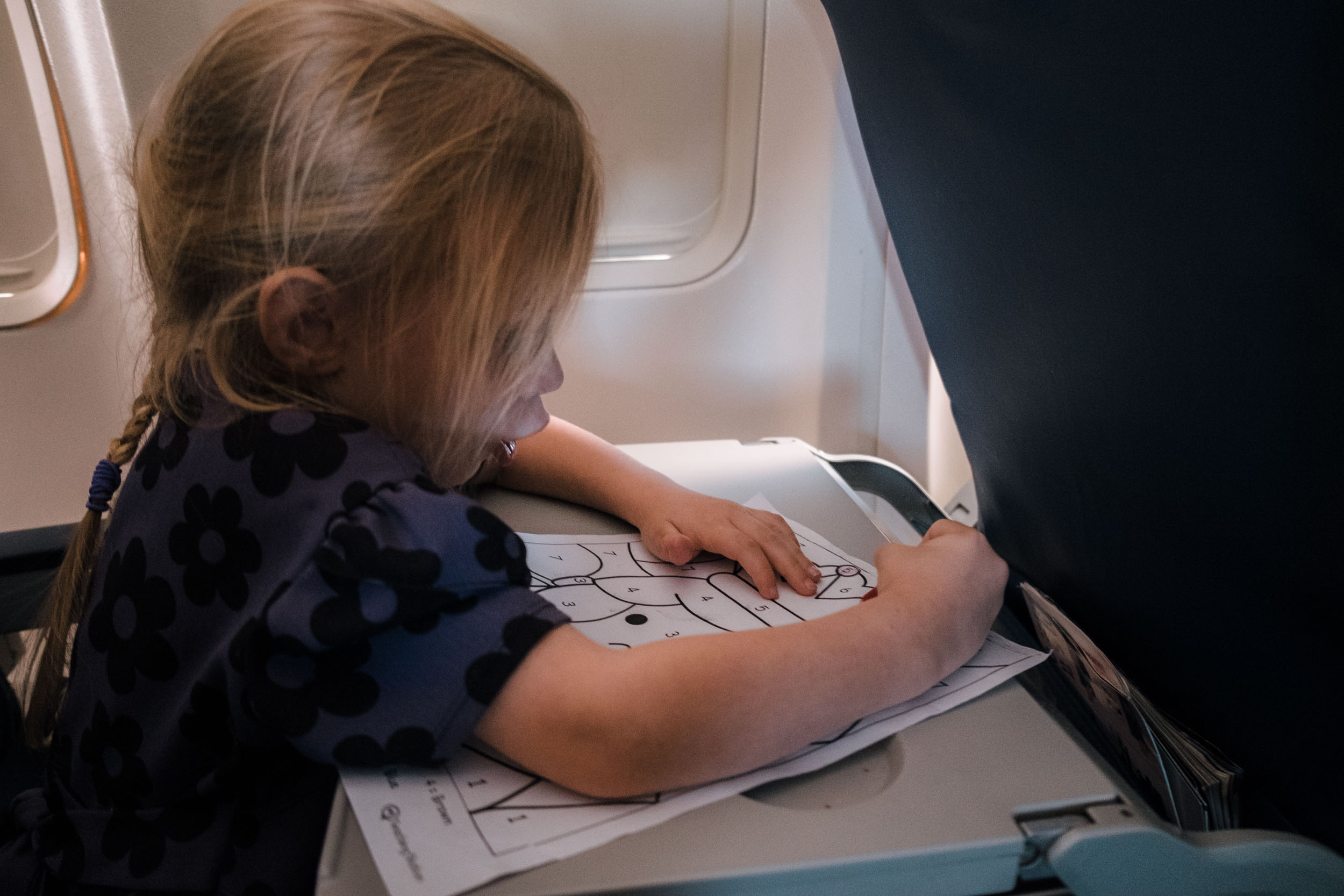 Girl coloring while flying