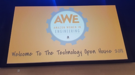 Three large screens displayed the AWE logo to welcome everyone.