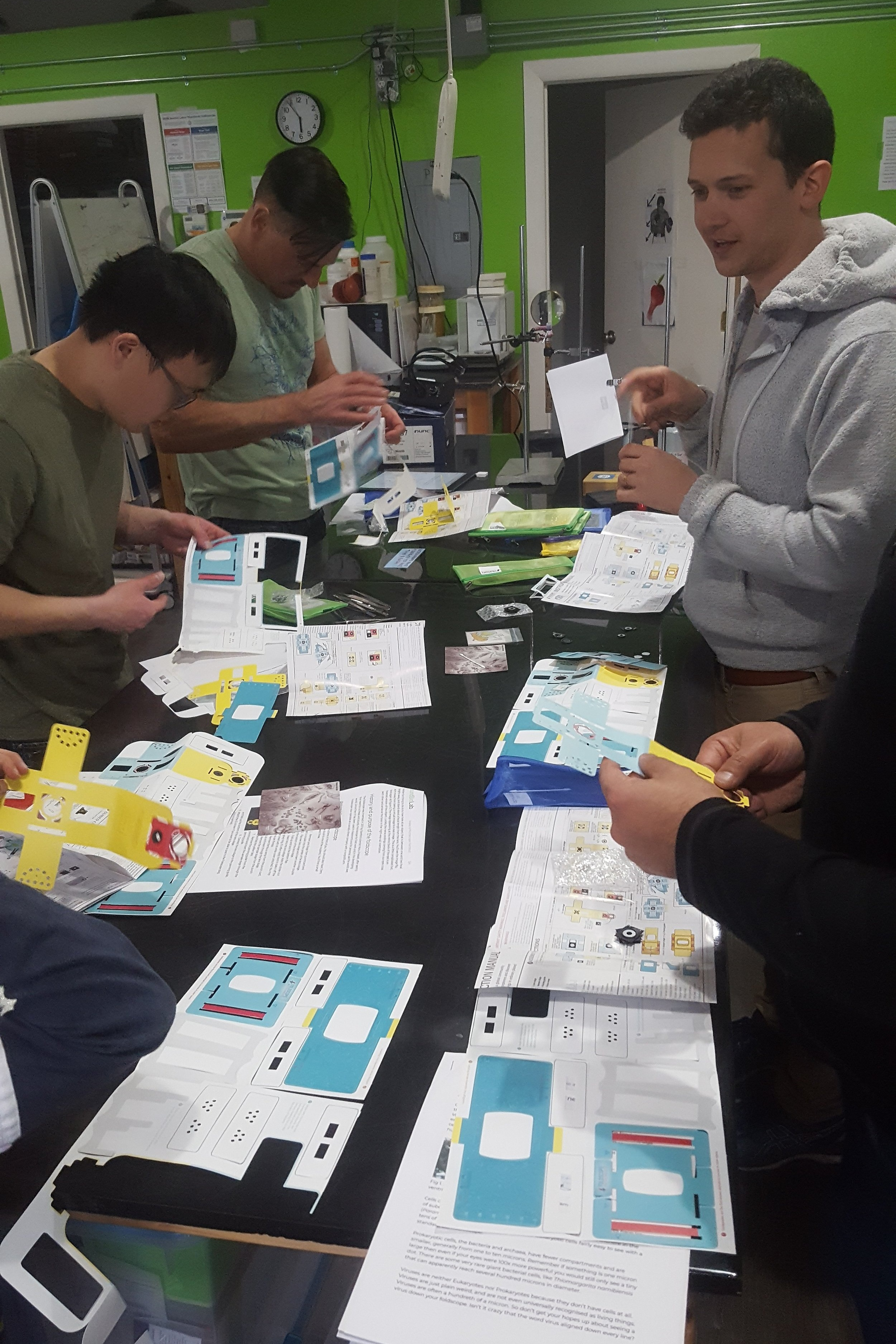 Building Foldscope Microscopes in the lab.