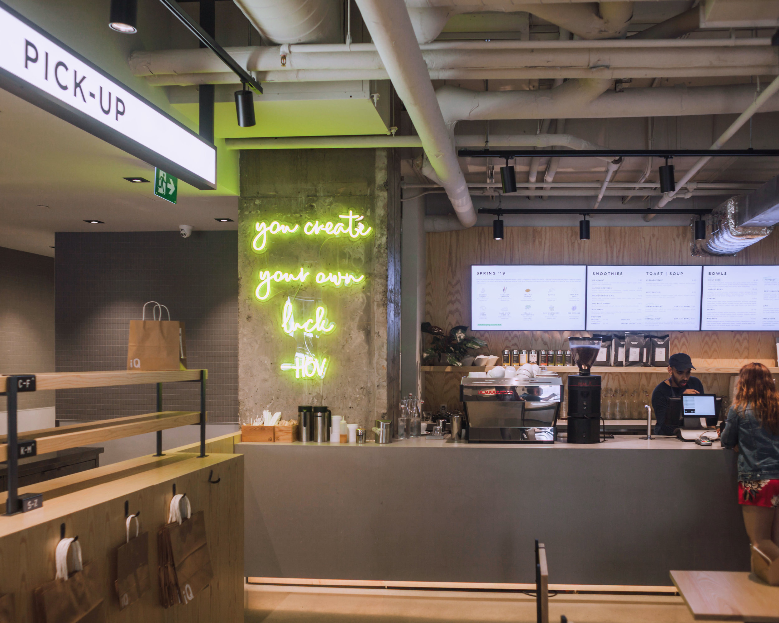 The interior of iQ's newest St. Clair location is clean, minimal, and filled with inspiring & motivational messaging to make your day a little brighter.