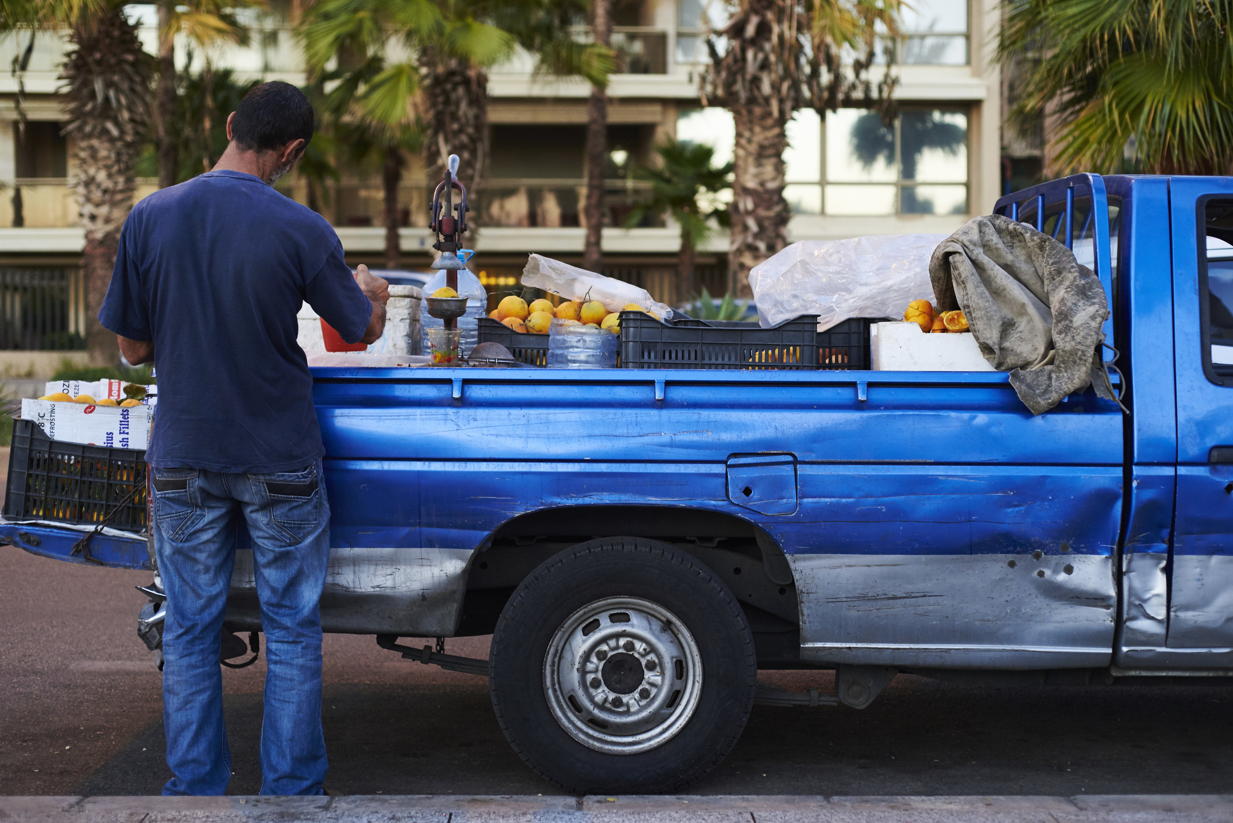 Informal economy in front of the limestone headland of Dalieh al-Raouche, along the Beirut's seashore, Lebanon, 2015.