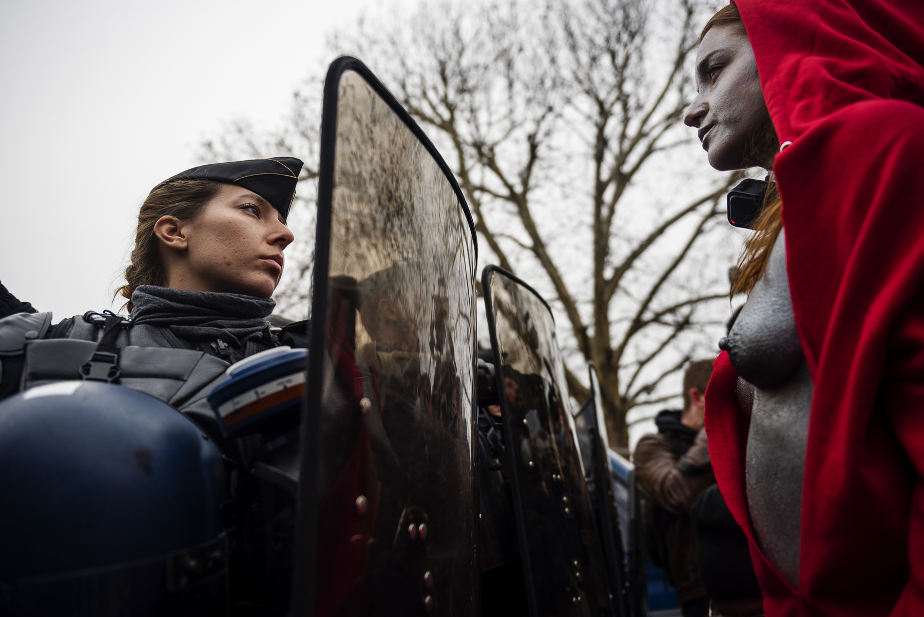 Women dressed as the 'Marianne', the national symbol of the French Republic, face French Gendarmes in the Champs Elysees Avenue in Paris, on December 15, 2018, as they take part in a demonstration called by the 'Gilets Jaunes' ('Yellow Vest') to protest against rising costs of living they blame on high taxes. Despite French government ministers appeals to the nationwide 'Gilets Jaunes' ('Yellow Vest') protests to stop in the wake of the Strasbourg attack that killed three people on December 11, protesters took the streets of France for the fifth consecutive Saturday. The 'Gilets Jaunes' ('Yellow Vest') movement - began on November 17, 2018 and inspired by opposition to a new fuel tax - has absorbed a wide range of anti-government sentiment and wrecked Paris and other French cities for over a month.