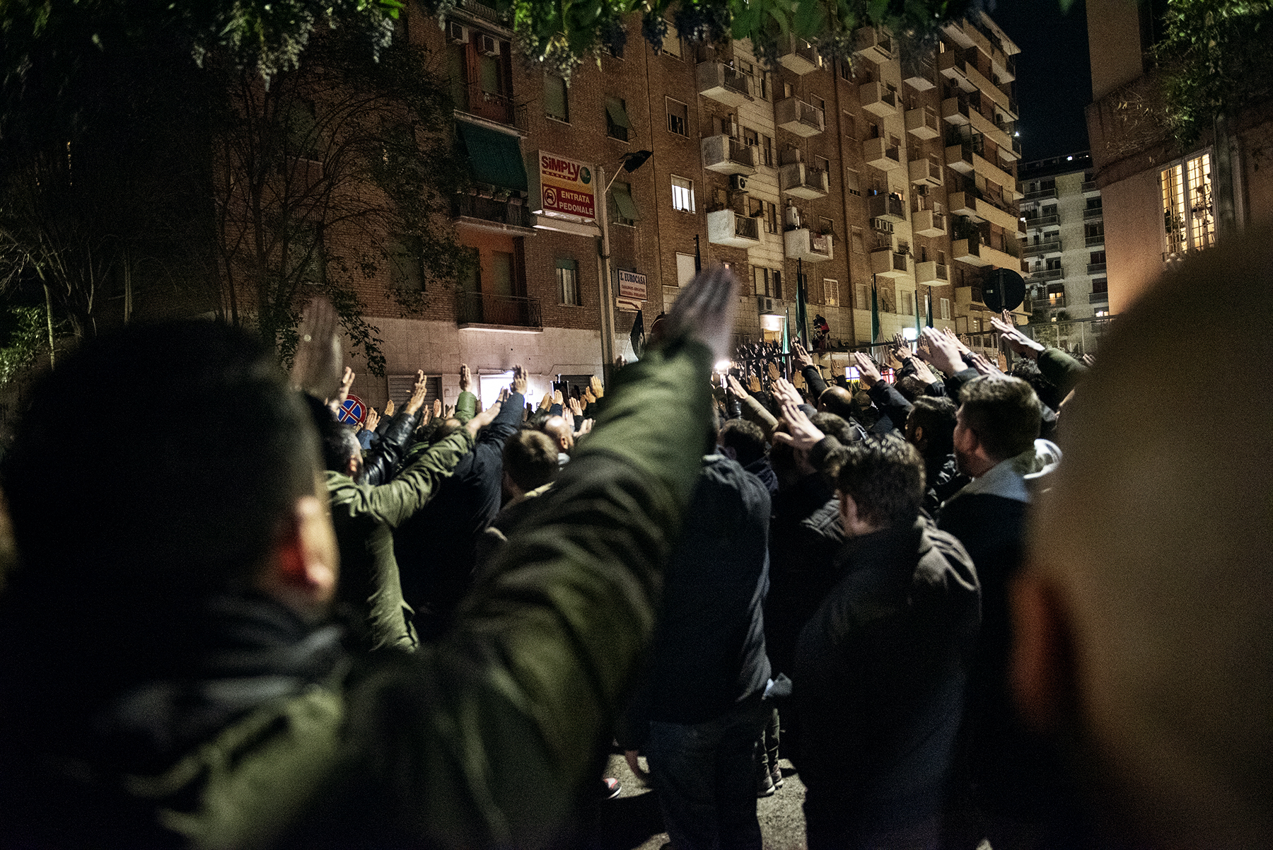 Casapound far-right wing militants do the Nazi salute in front of former MSI (Italian Social Movement) party branch during the 41st anniversary of Acca Larentia killings in Rome, Italy, on January 07, 2019.The Acca Larentia killings refers to the political killing of three fascist activists - Franco Bigonzetti, Francesco Ciavatta and Stefano Recchioni - of the Youth Front of the Italian Social Movement the evening of January 7, 1978, in Rome. In past years, Italian far-right movements such as Casapound have used the Acca Larentia's anniversary as a main event in their political agenda, gathering thousands of militants from all around the country.