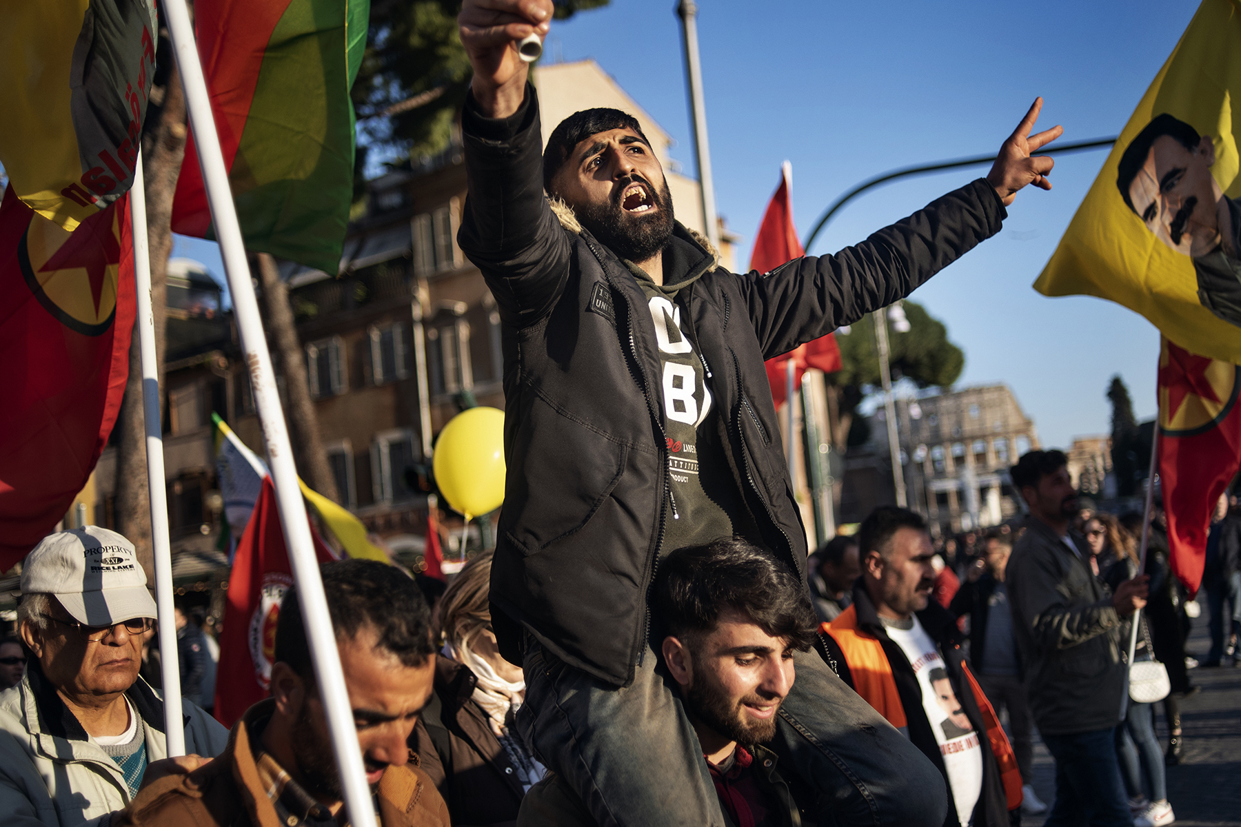 A Kurdish protestor flashes the V sign as he takes part in a protest rally near the Coliseum (Colosseum, Colosseo) in Rome on February 16, 2019, part of a nationwide demonstration organised by Kurdish communities in Italy. The protests are being held to call for the release of jailed PKK leader Abdullah Ocalan and other political prisoners.