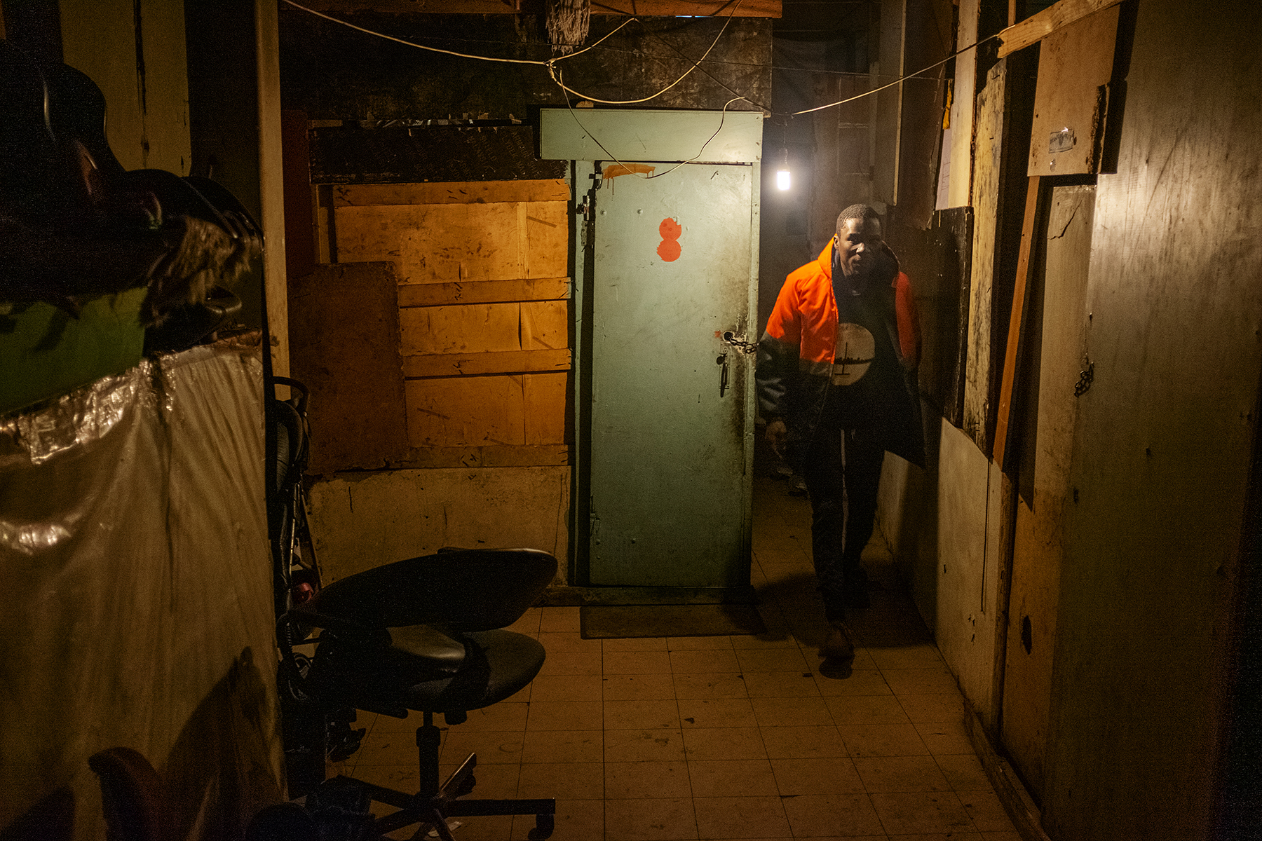 Scelo Sithole, 38, leaves his quarter at the Newtown hostel complex in the early morning of June 12, 2019, to start his day as an informal waste picker in Johannesburg, South Africa.