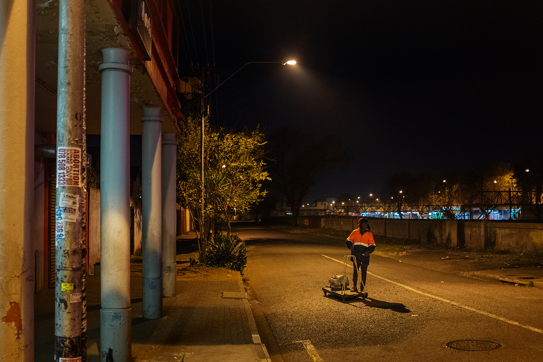 Scelo Sithole, 38, walks carrying his trolley in the streets of Johannesburg, South Africa, in the early morning of June 12, 2019, to start his day as an informal waste picker.