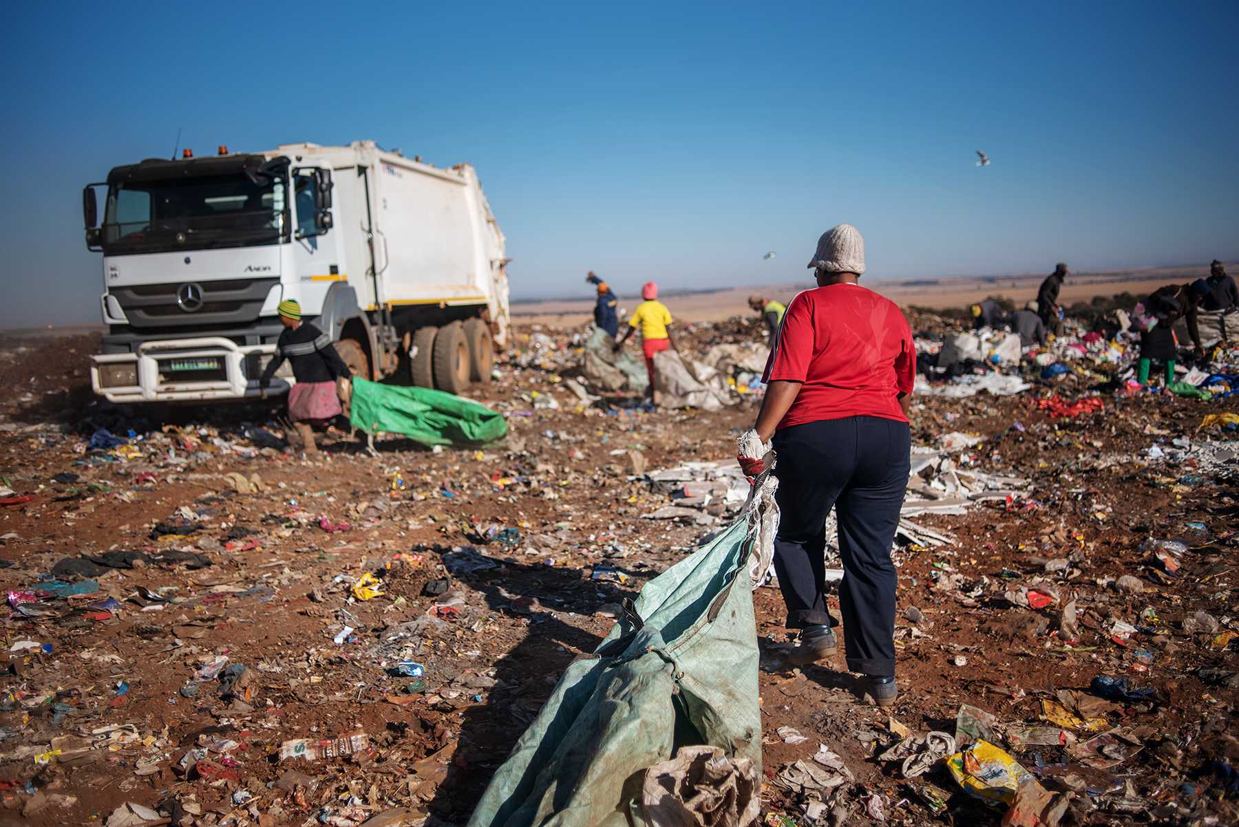 Eva Mokoena, a 33 years old South African informal waste picker, approaches a garbage truck at the Palm Springs landfill in the outskirt of Johannesburg, South Africa, on June 28, 2019.