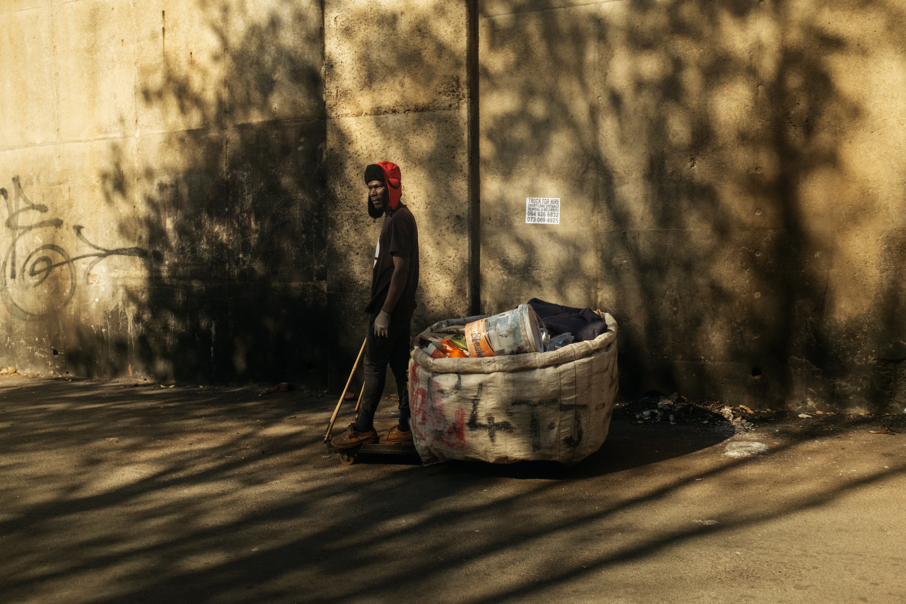 Scelo Sithole, 38, rides his trolley filled with waste collected from trash bins in the early morning of June 12, 2019 in Johannebsurg, South Africa.