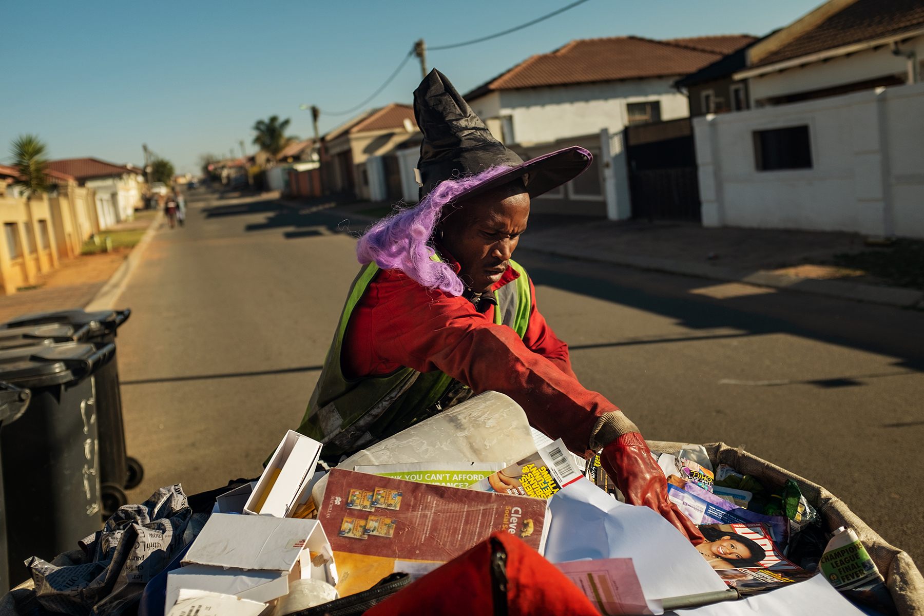 Tumelo Ikaneng, 21, separates waste collected from trash bins in the early morning of June 12, 2019 in Johannebsurg, South Africa.