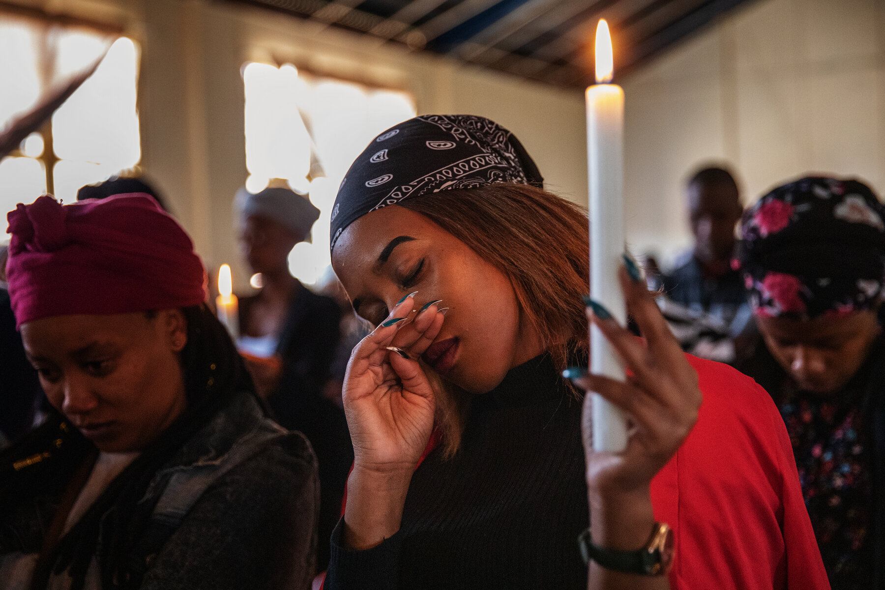 A woman reacts while praying at the joint memorial service of Keobakele Isaac Sebaku and Karabo Ditire in Johannesburg Coronationville suburb, on September 07, 2019, near where the two South African nationals were shot dead on September 03. South Africa's financial capital was recently hit by a new wave of violence mostly targeting foreign nationals.