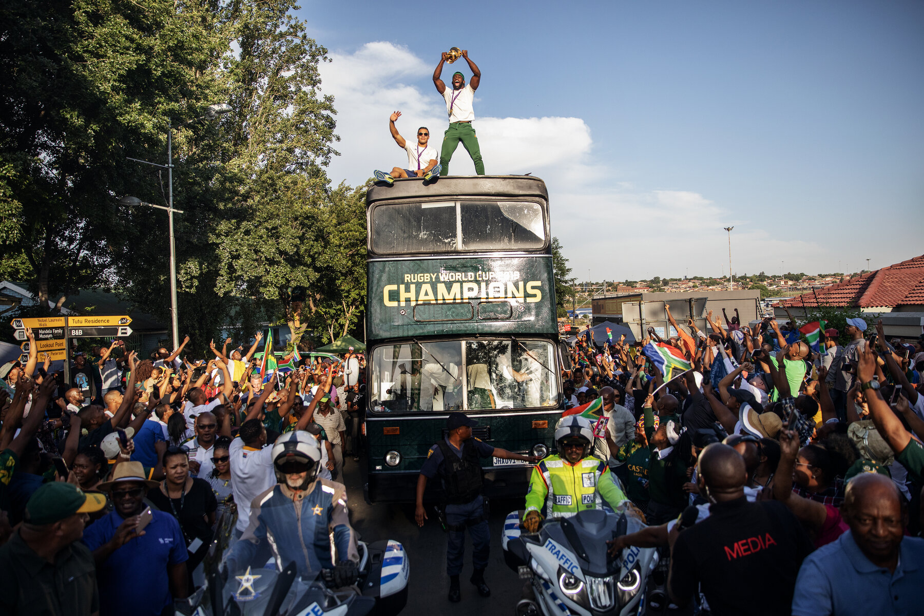 South African Rugby captain Siya Kolisi holds up the Web Ellis trophy as the World Cup winner team parades Vilakazi street in Soweto on an open top bus on November 7, 2019 in Soweto, South Africa.