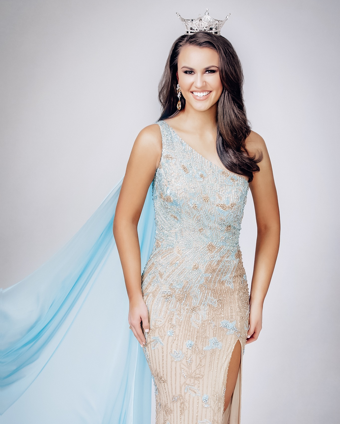 Photo: Zac Grimaldo Photography, Hair and Makeup: Nicole West, Gown: Sherri Hill from Terry Costa and Sergio Armas