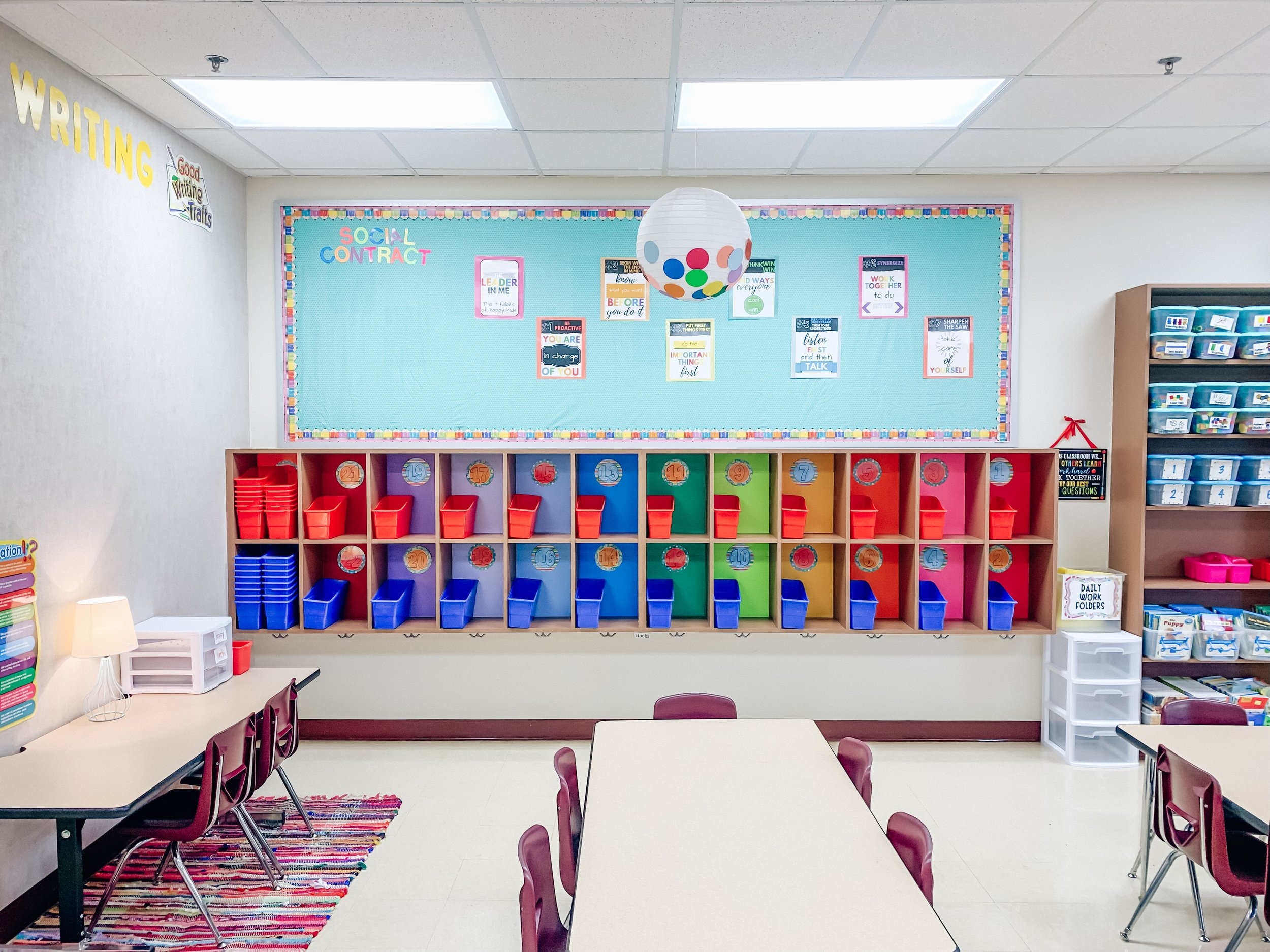 Happy cubbies! Each kiddo has their own cubbie to store folders, spiral notebooks, books and headphones in. And their backpacks hang below!