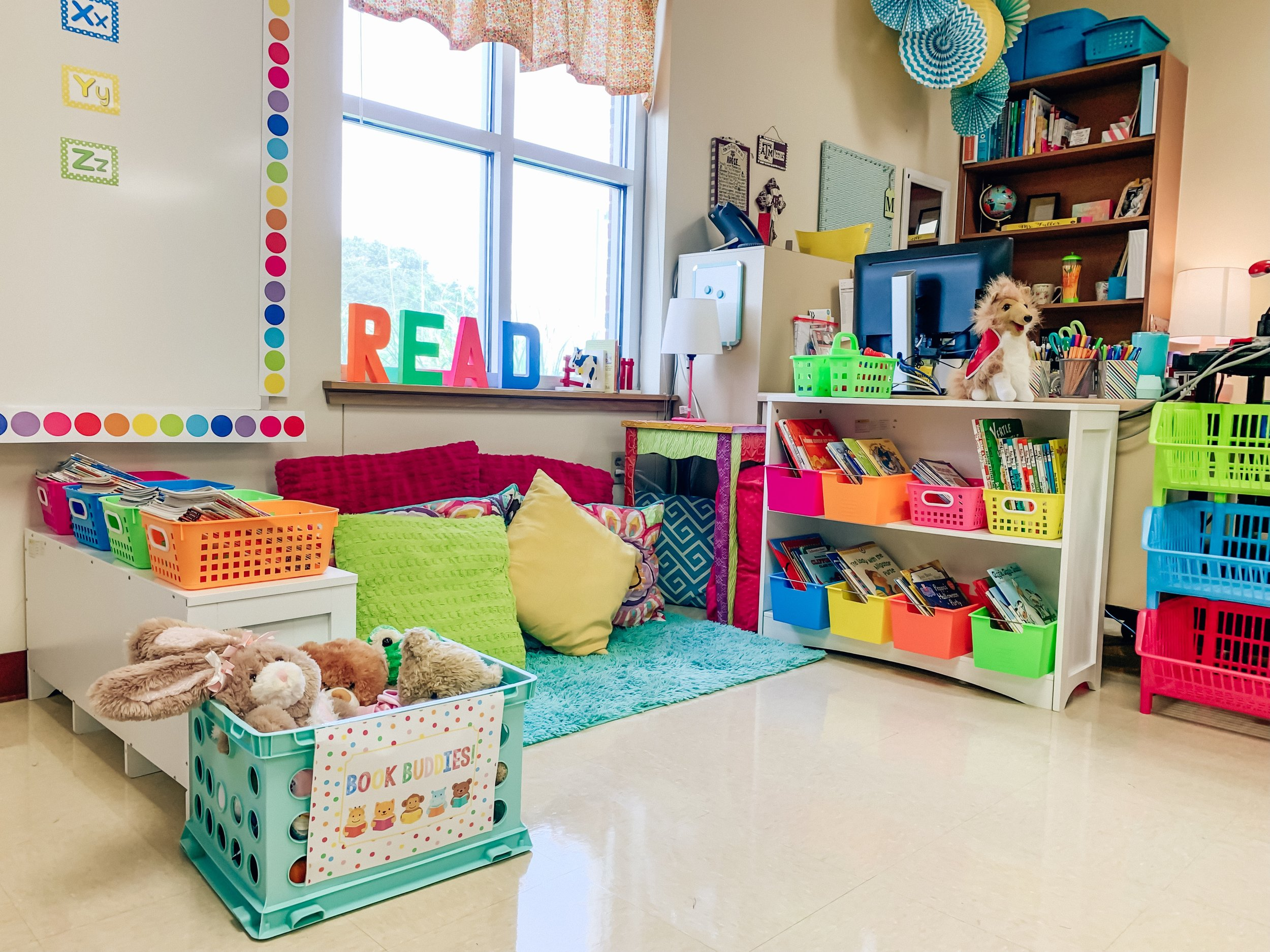 Our reading corner, complete with lots of different books, comfy pillows, a little lamp, book buddy stuffed animals, and of course our class mascot, Miss Rev.