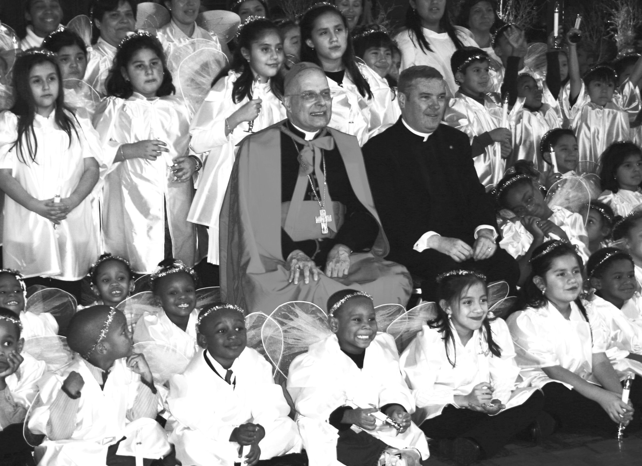 Cardinal George and Monsignor Boland with the children at the Catholic Charities St. Nick Ball.
