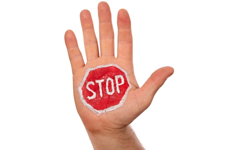 hand_with_painted_stop_sign.jpg