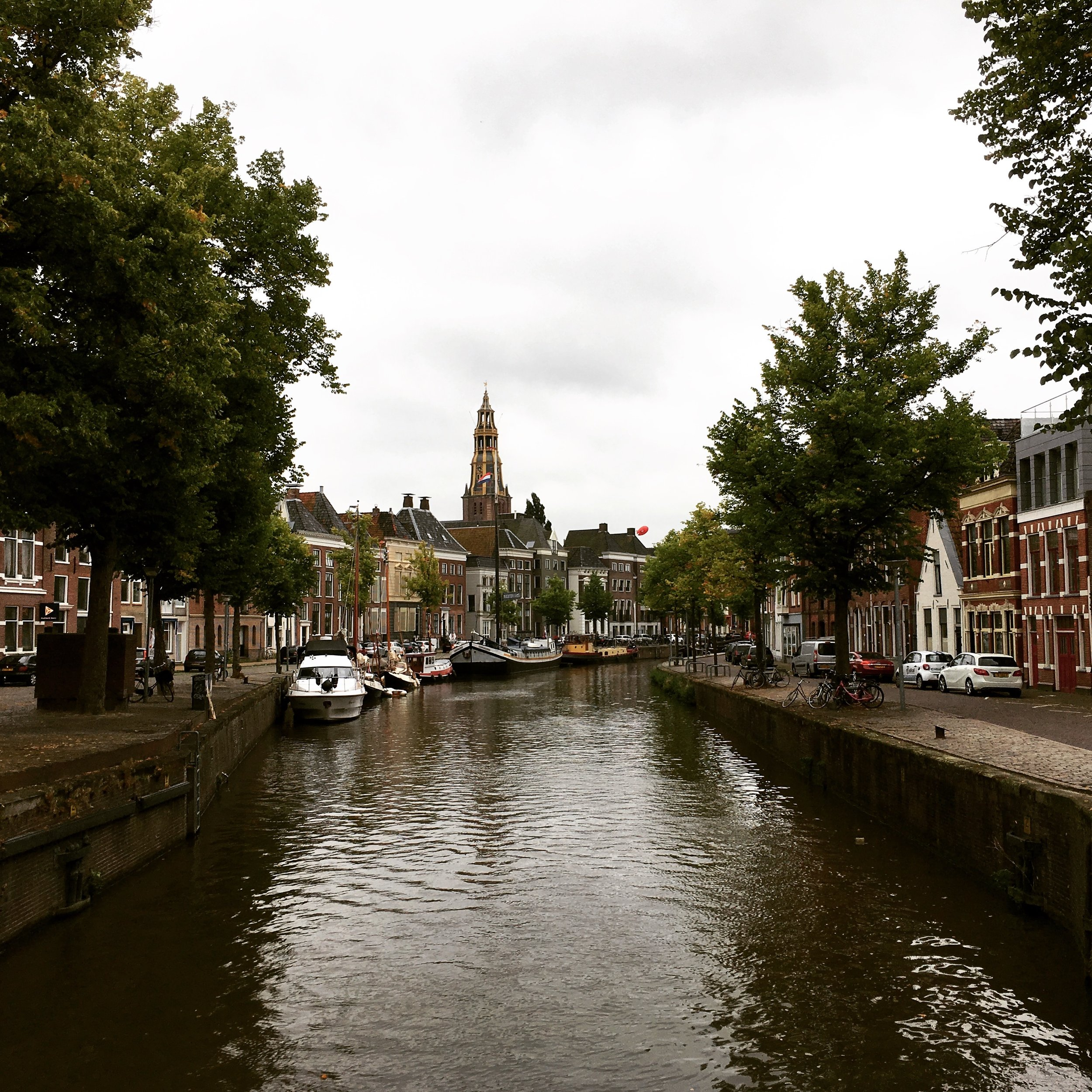A view of the Martinitoren in the distance from a canal in Groningen, The Netherlands.