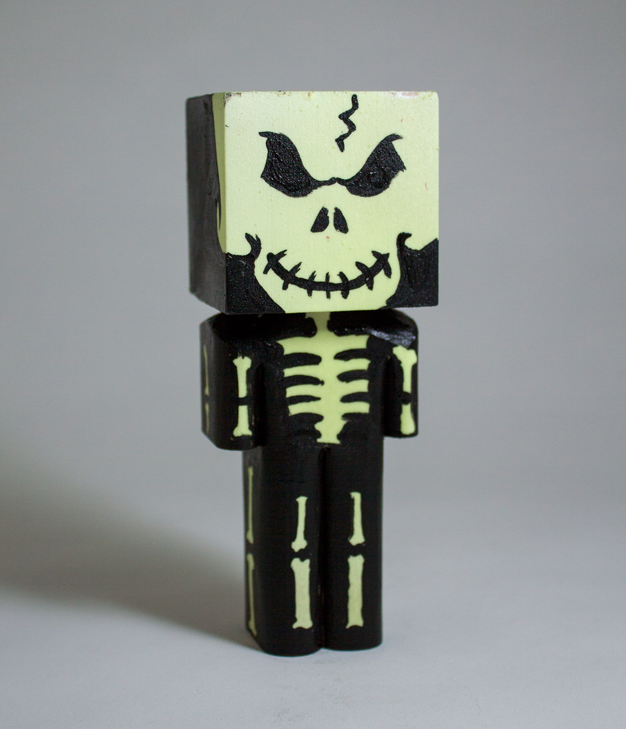 Glow in the Dark Skeleton in collaboration with Chris Veal  wood and phosphorescent paint 5.5 x 2 x 2 CSK 024G