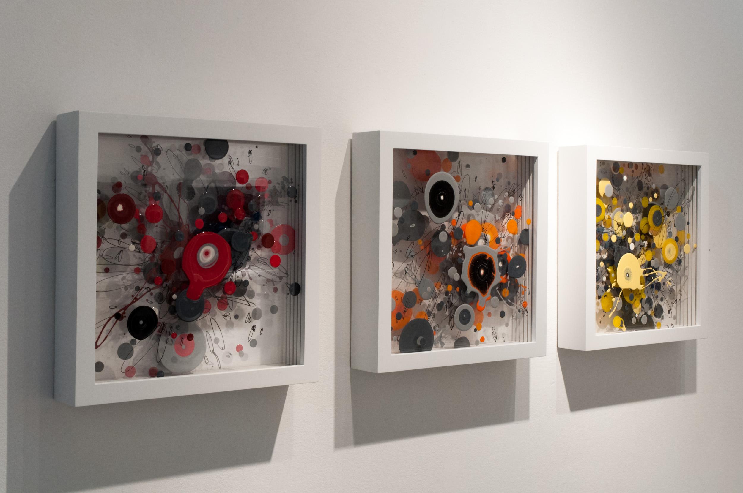 "(left to right) ""CPO3"" WGR 058G, ""CPO4"" WGR 059G, & ""CPO5"" WGR 060G, enamel on layered plexiglass. 14 x 14 x 3 inches."