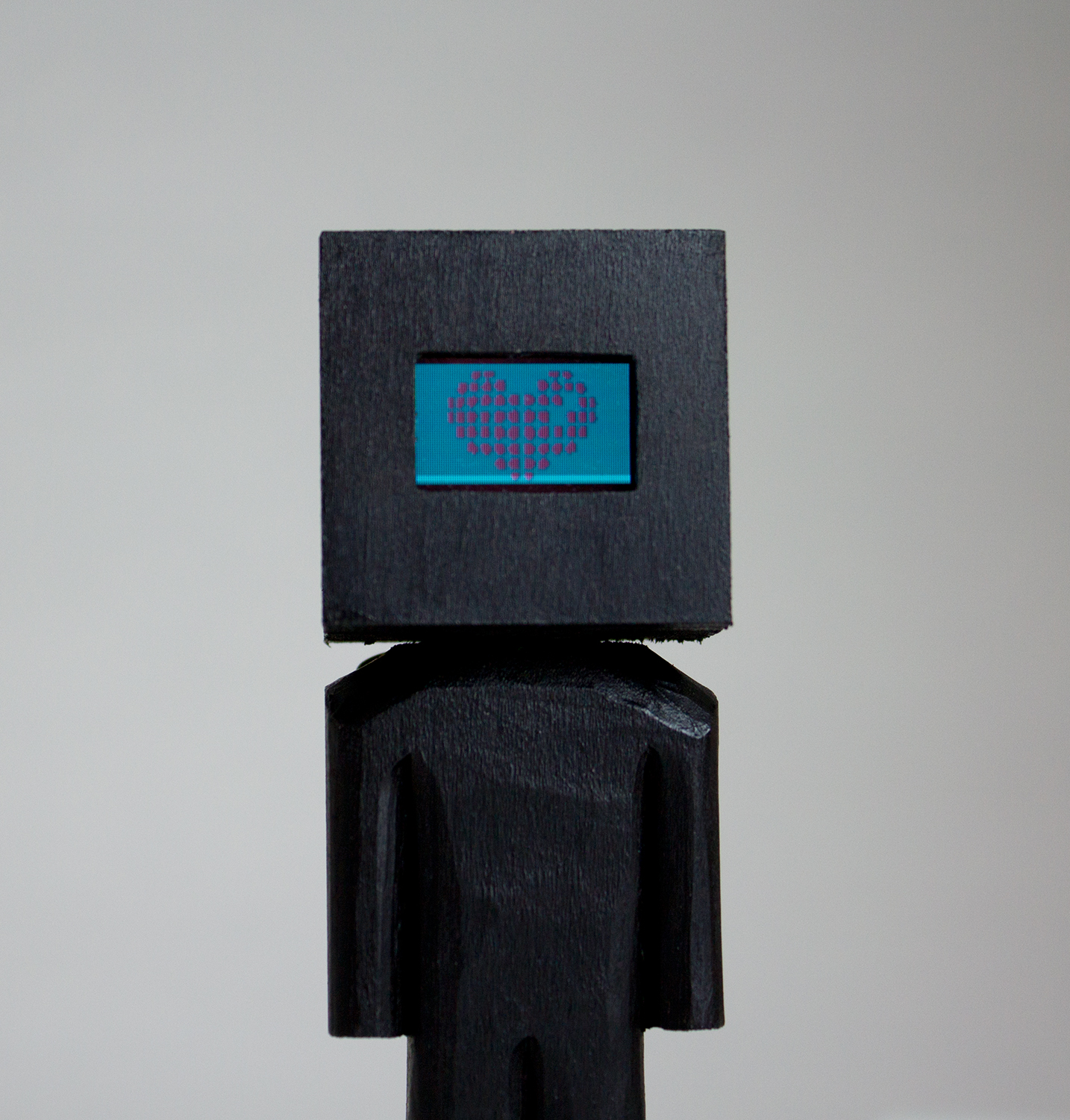 """""""Glitched Head"""" Collaboration with AtlTvHead. Basswood, acrylic, and digital components. 5.25 x 1.5 x 1.5 inches. CSK 020G"""